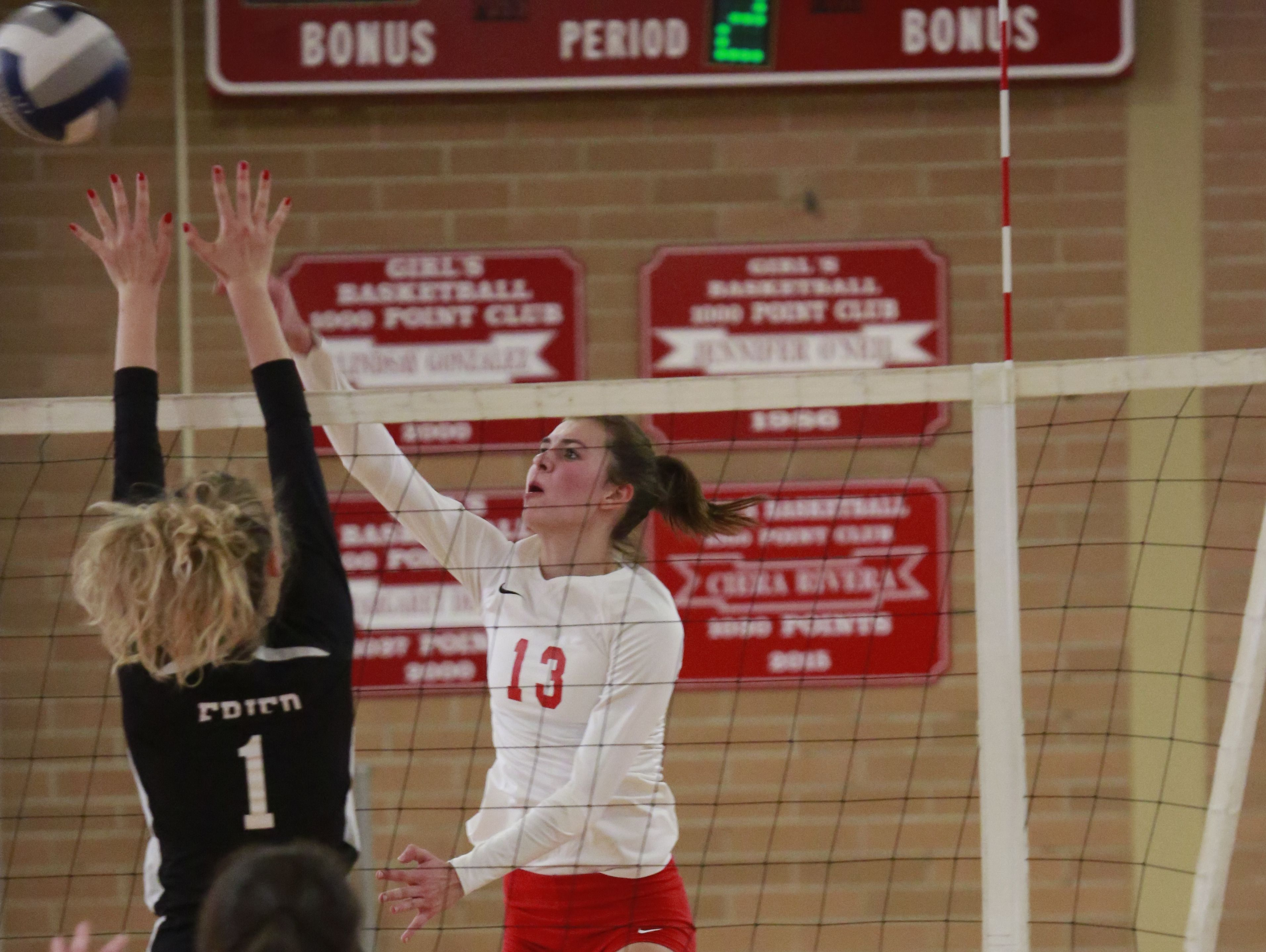 North Rockland volleyball player Madison Monahan (13) returns the ball against Scarsdale at North Rockland High School in Thiells on Oct. 31, 2016.