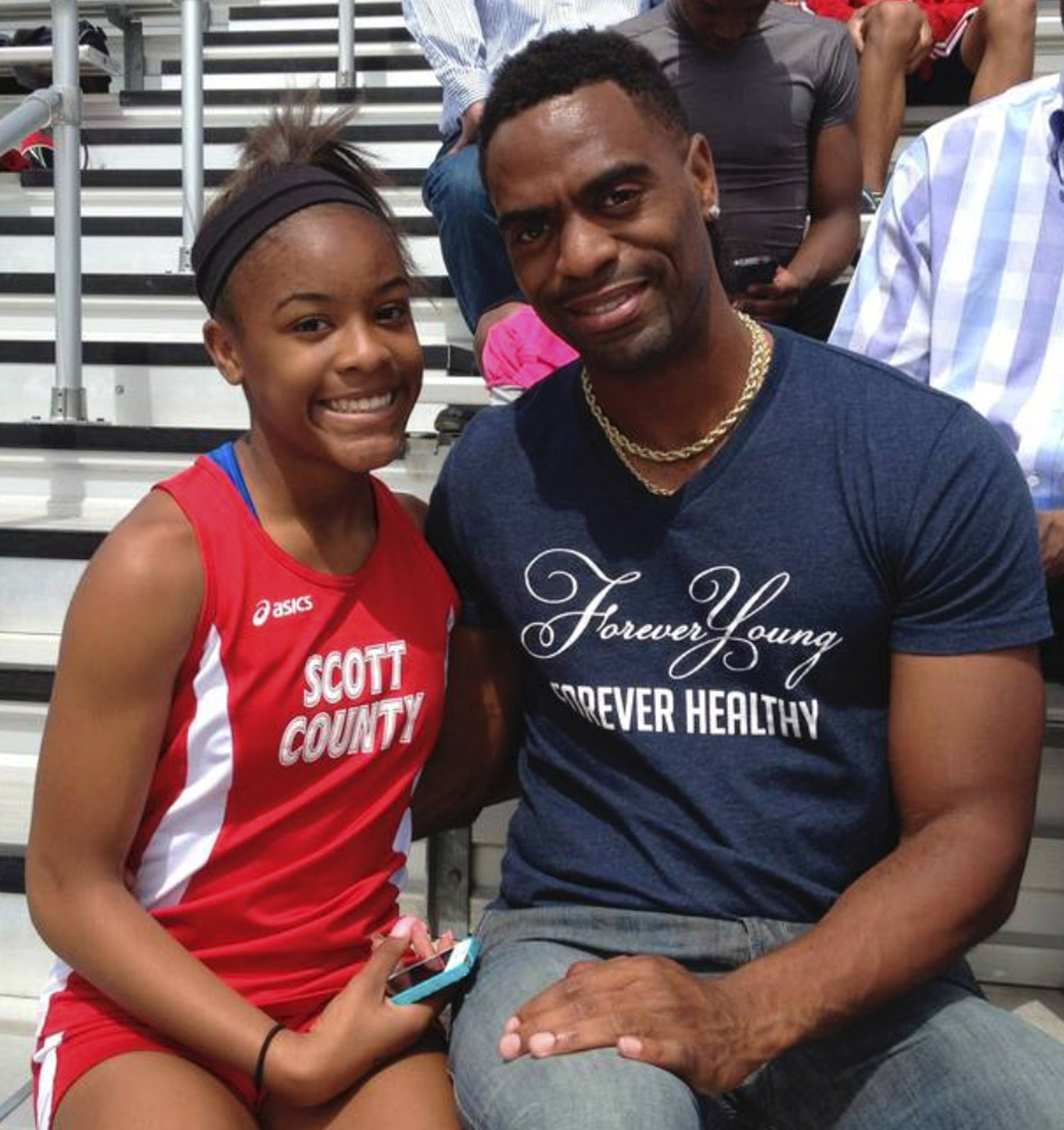 Trinity Gay, a seventh-grader at the time racing for her Scott County High School team, poses for a photo with her father Tyson Gay. (Photo: Mark Maloney, AP)