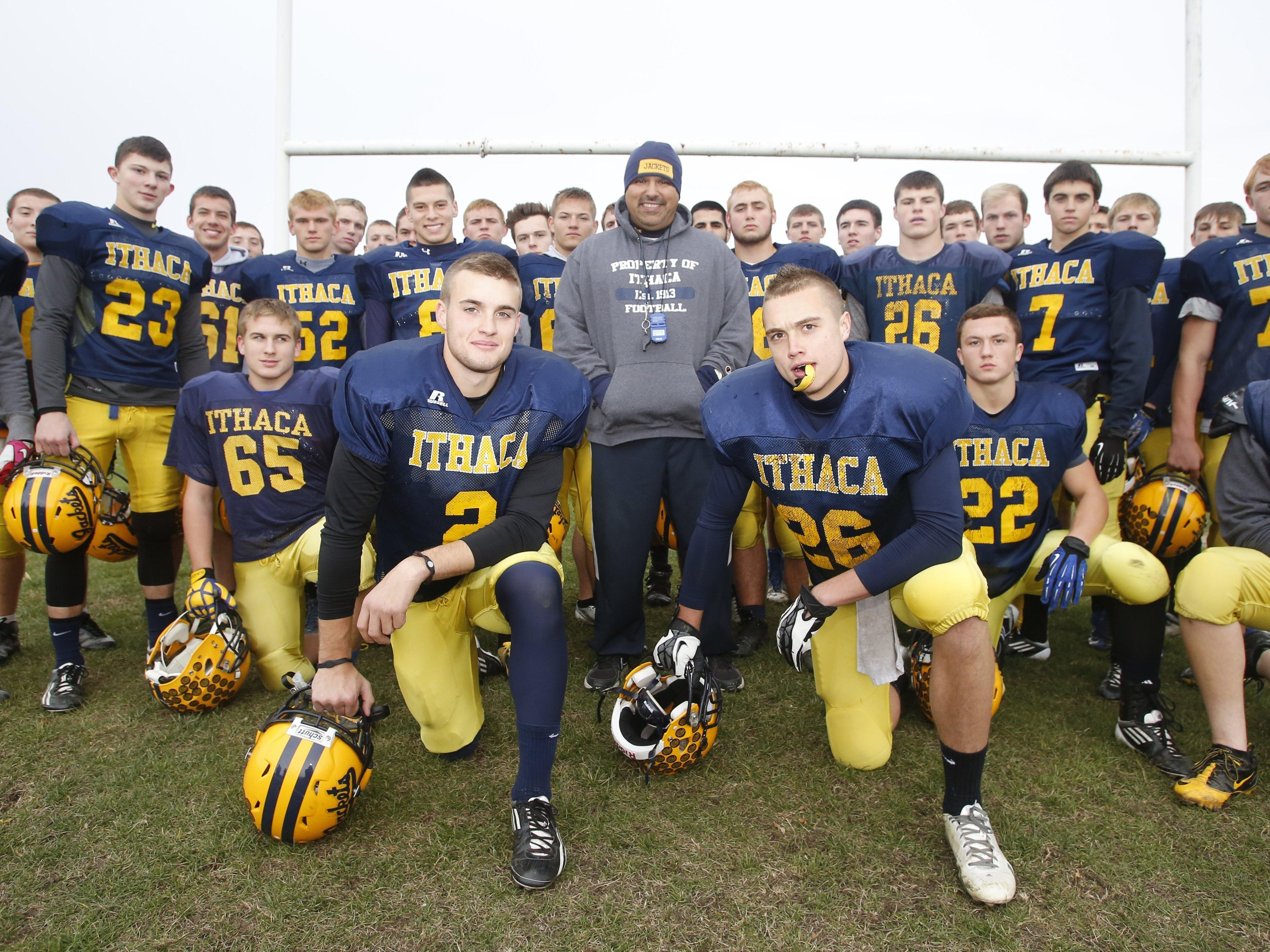 """Ithaca head coach Terry Hessbrook, shown here surrounded by the 2013 Yellowjackets, is the star of the documentary, """"Ithaca: The Climb."""""""