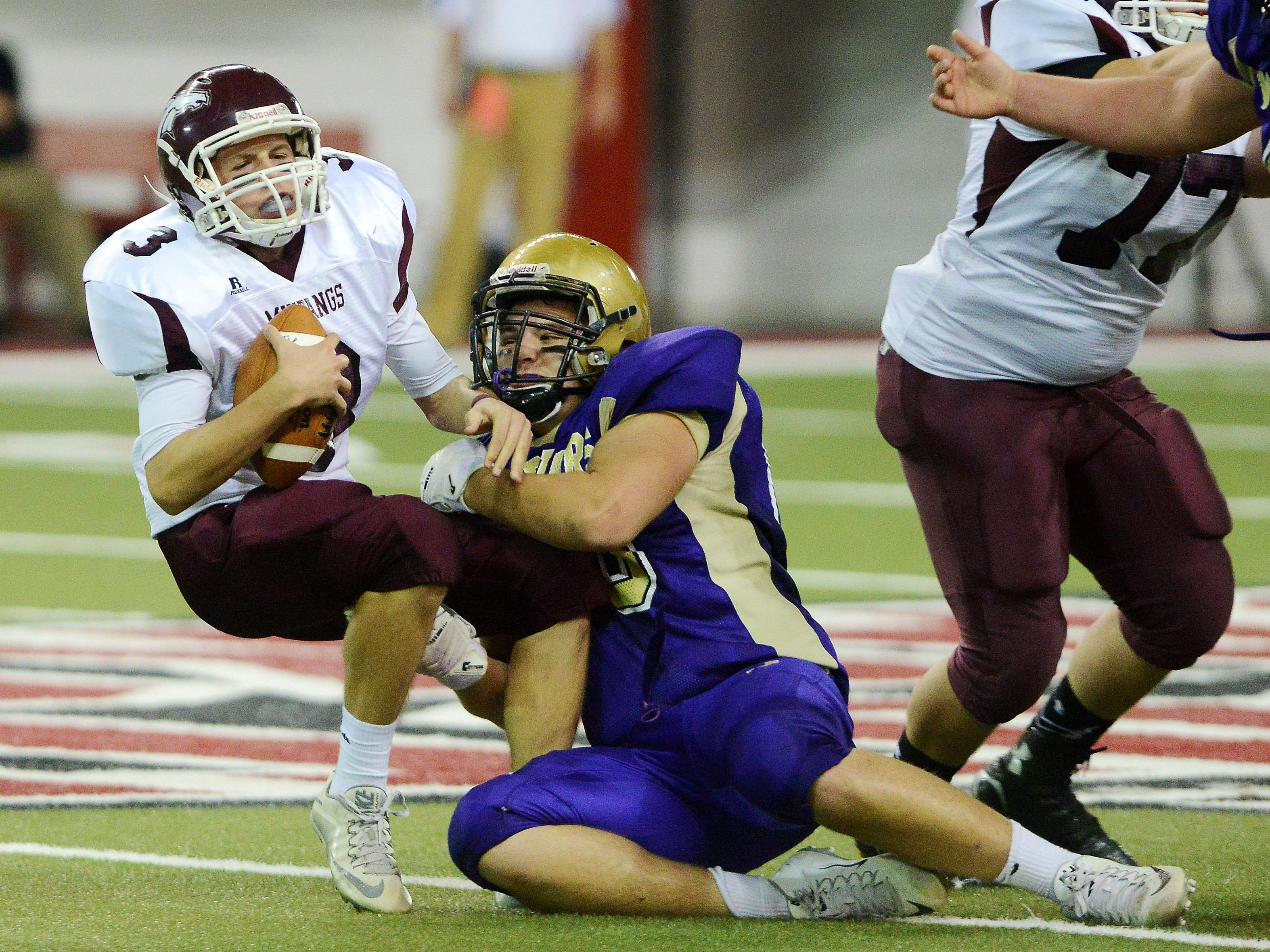 Tri-Valley's Noah Jewett is taken down by Winner's Wyatt Ewing in the Class 11B championship game. Jewett and the Mustangs lost that game 45-6, finishing the year at 7-5. Tri-Valley played five of its eight regular season games in 2015 against Class 11A schools and has done the same in 2016.