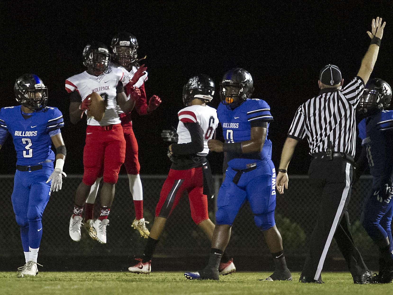 South Fort Myers' E'Quan Dorris celebrates after scoring a touchdown in the first half of his game against the Ida Baker Bulldogs in Cape Coral Friday evening,