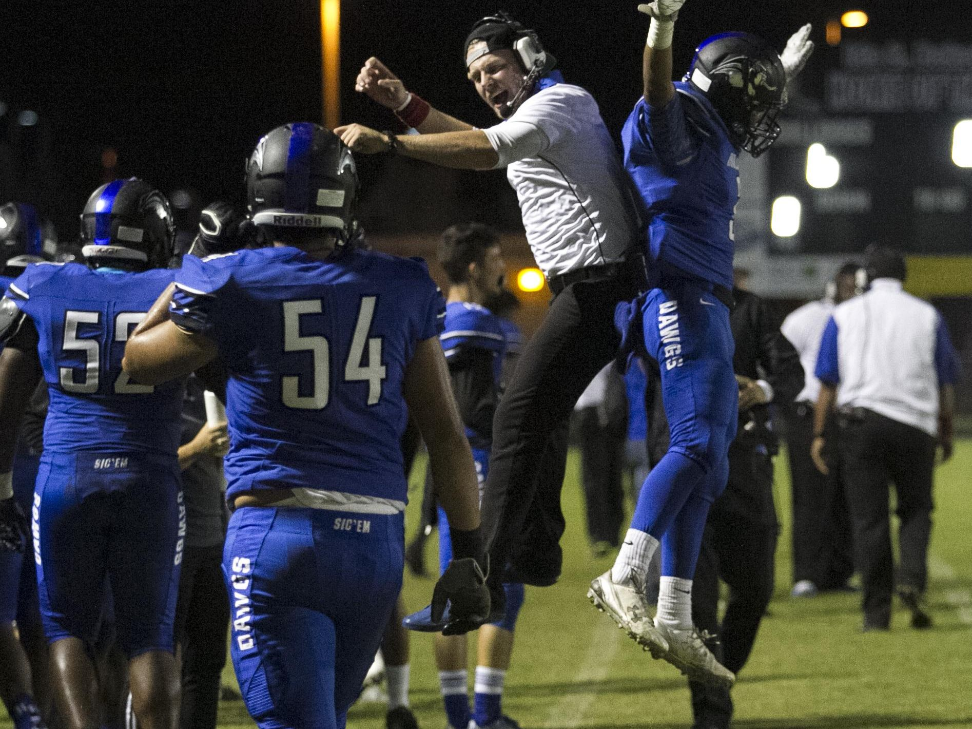 Ida Baker High School's wide receivers coach Cullen O'Brien celebrates with receiver Josh Nina after he scored a touchdown in the first half of their game against South Fort Myers Friday evening in Cape Coral.