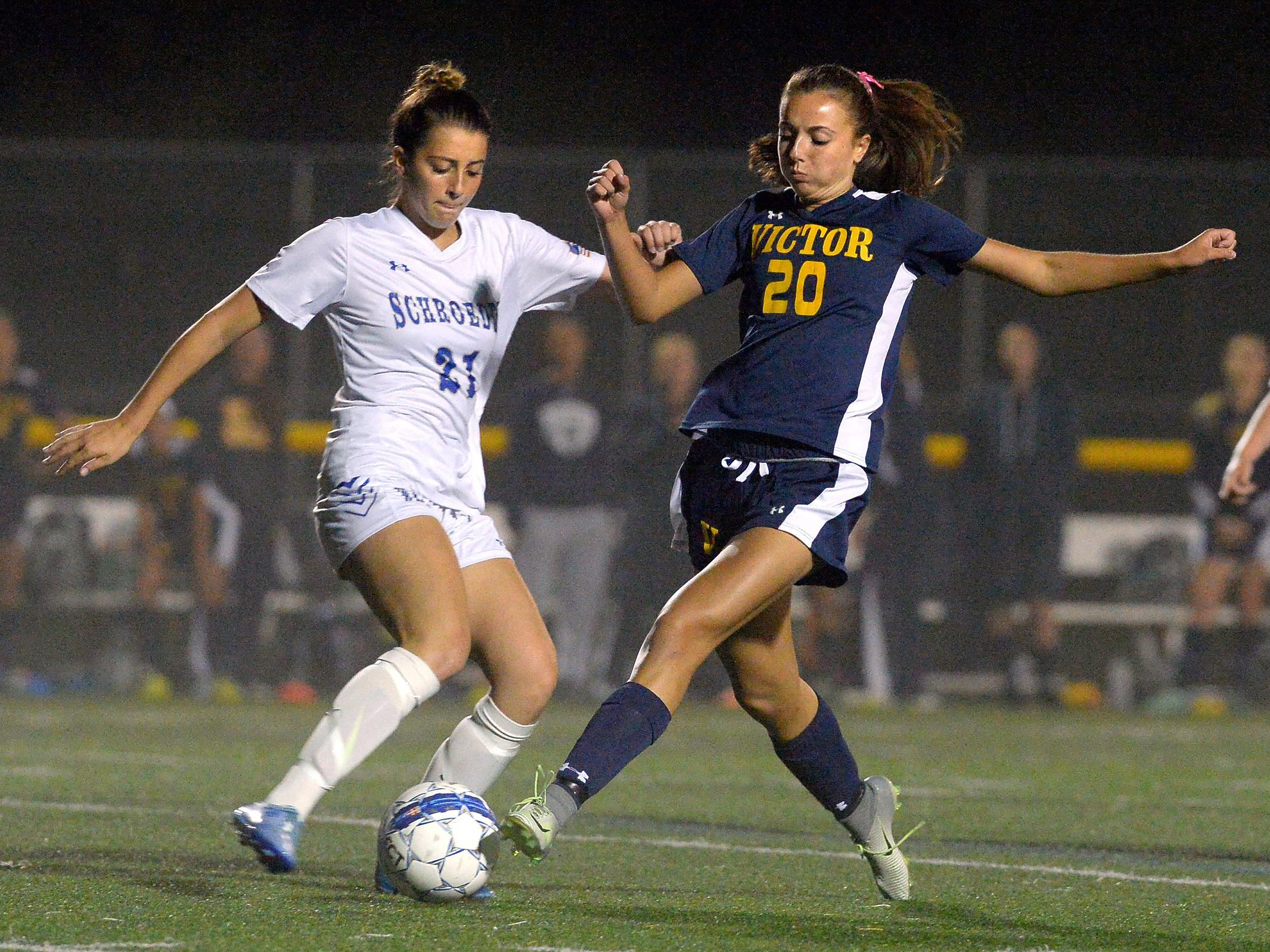 Victor's Lexi Perry, right, tries to block a clearance by Webster Schroeder's Nicole Ryan Wood.