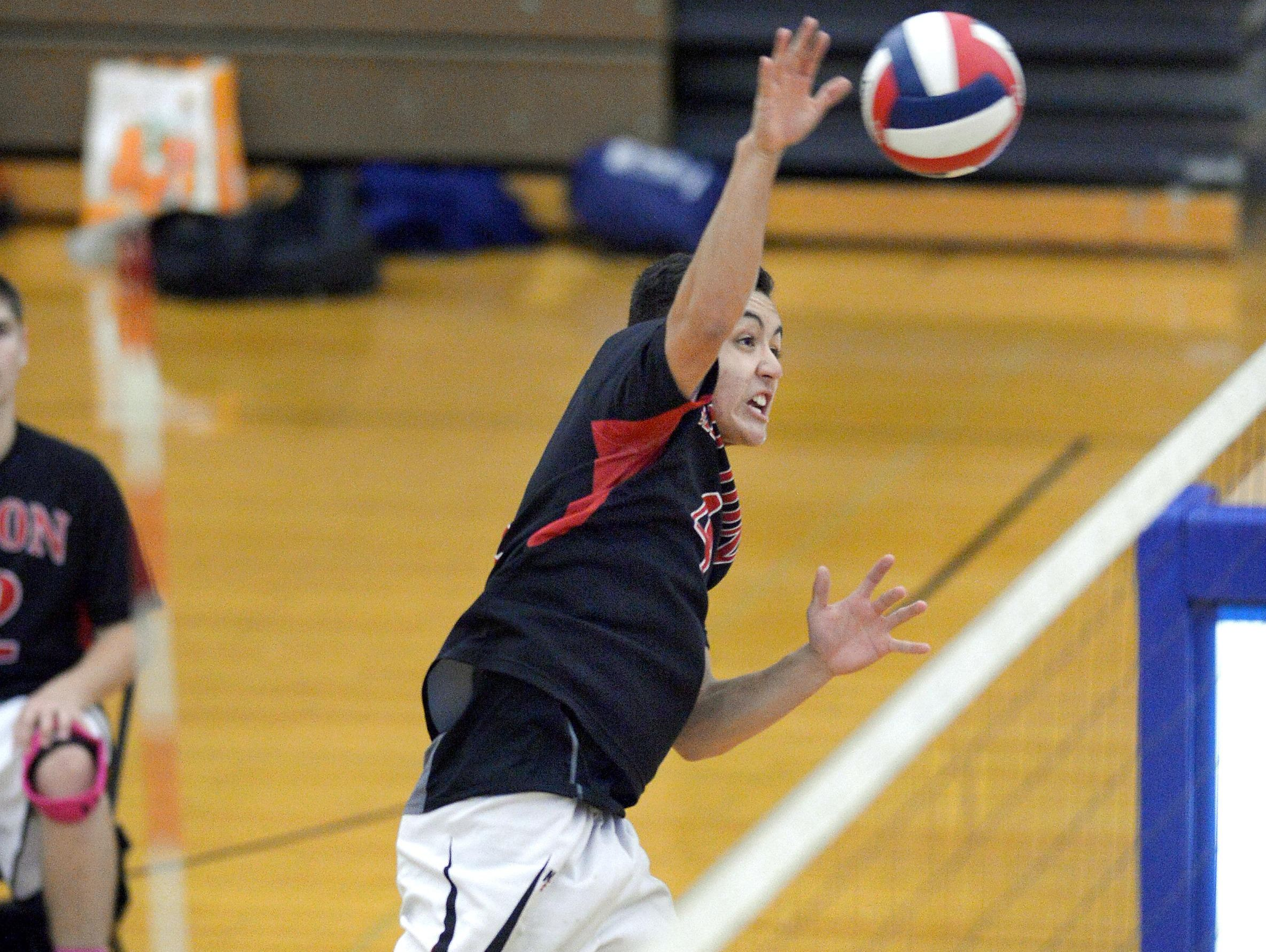 Hilton's Hunter Betrus takes a swing at the net.