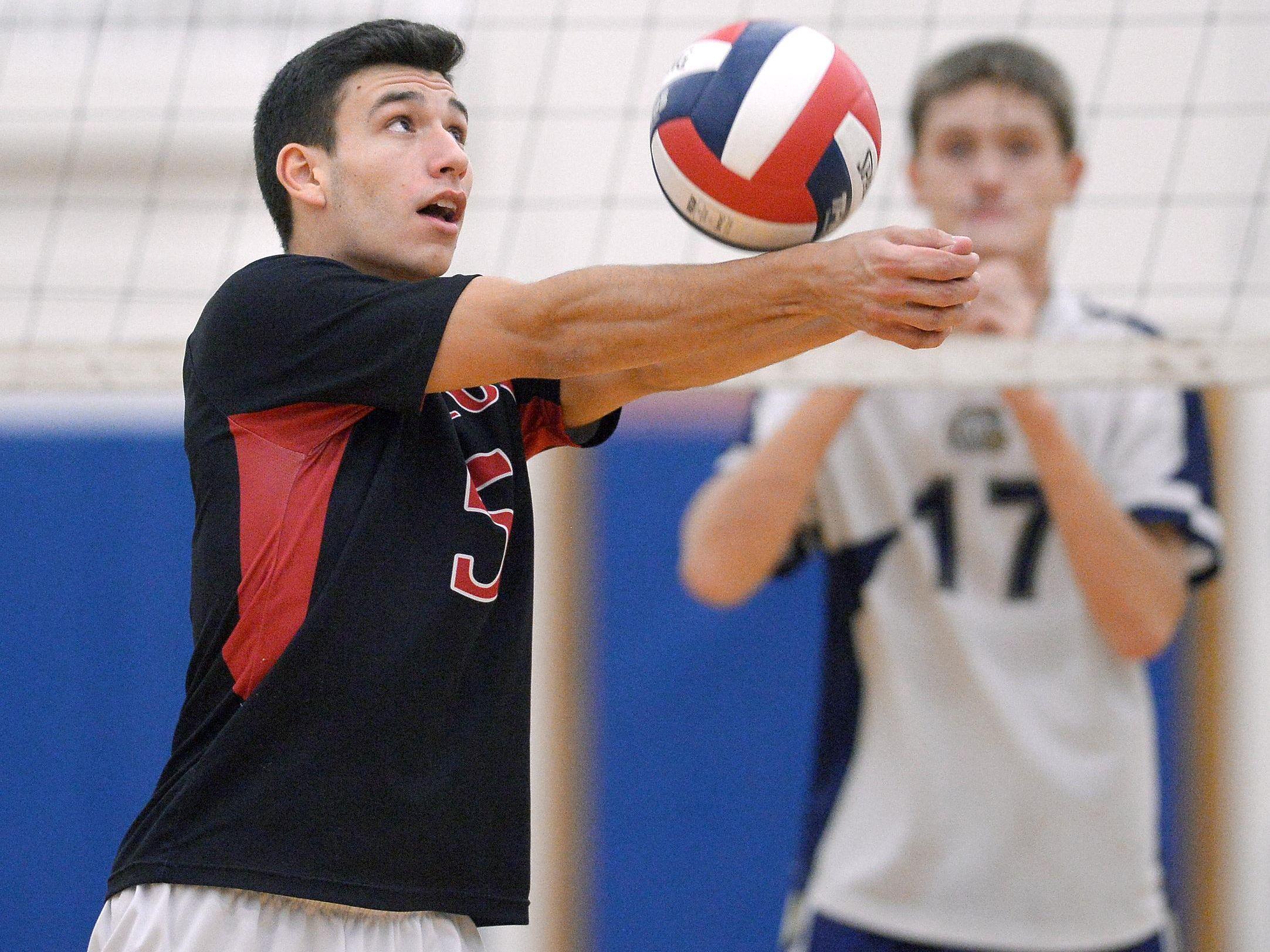 Hilton's Bryce Thompson bump sets the ball.