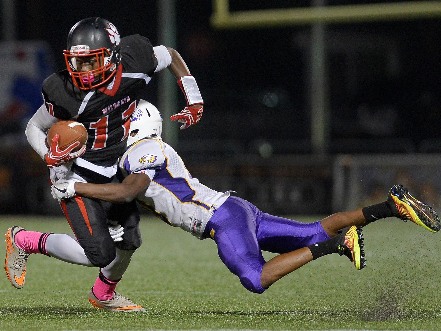 Wilson's Jervon Johnson is tackled by East's Zion Ponder after a reception at Rhinos Stadium on Friday. East won, 12-10.