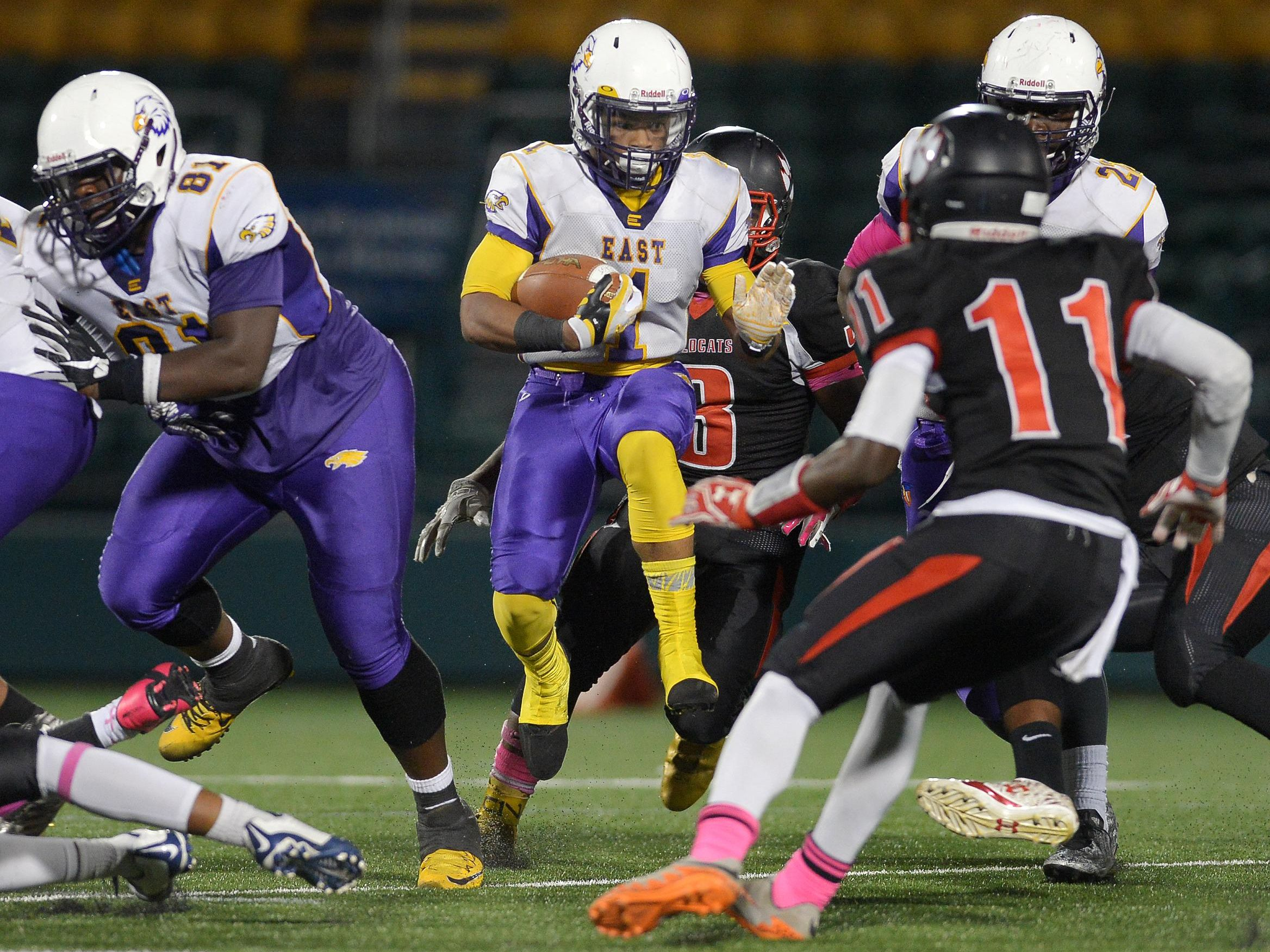 East's Isaiah Collier breaks through a hole in the line of scrimmage during a regular season game at Rhinos Stadium on Friday. East won, 12-10.