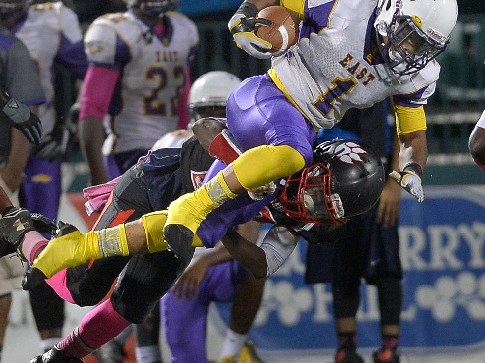 East's Isaiah Collier is tackled by Wilson's Jadeous Williams.