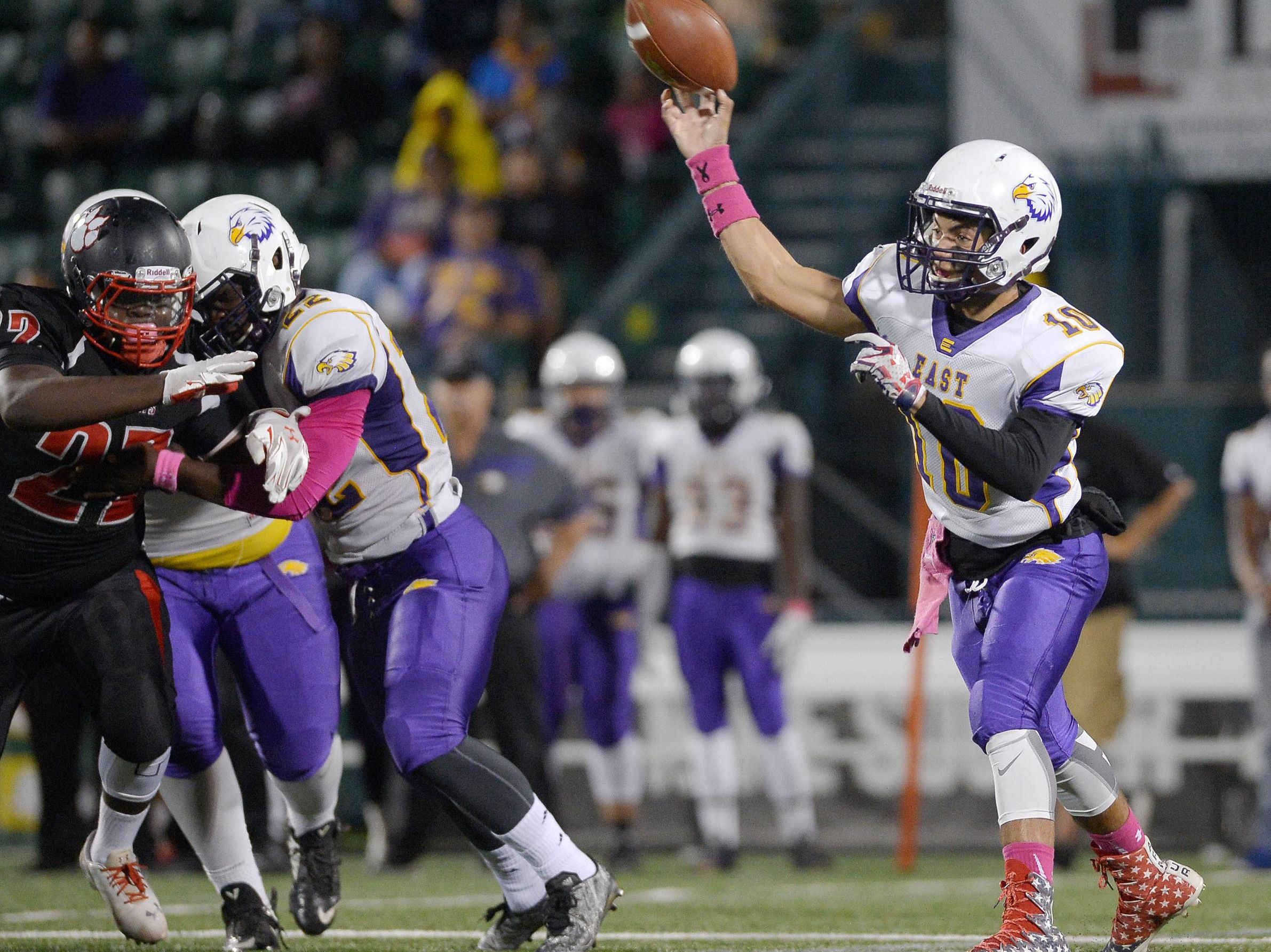 East quarterback Sam Sheldon throws from the pocket.
