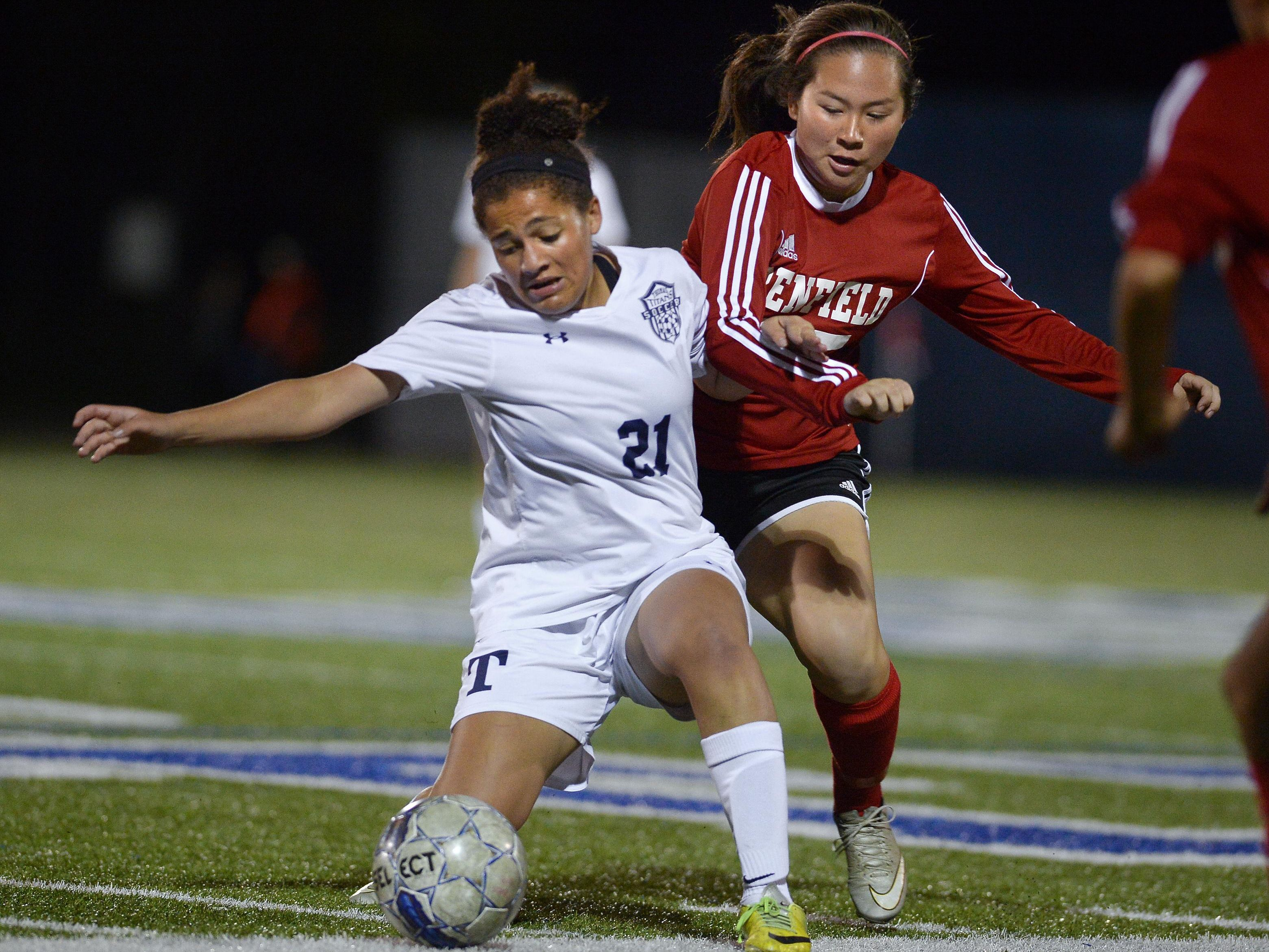 Webster Thomas' Amalia Barie, left, tries to shield the ball from Penfield's Megan Karp on Wednesday.