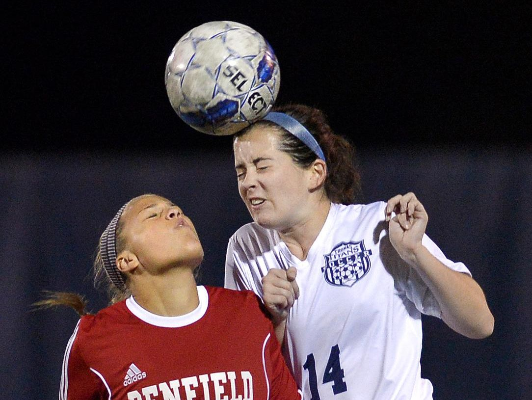 Webster Thomas' Micaela Johnson wins a header over Penfield's Alexandra Farrance during a game at Webster Thomas High School on Wednesday. Penfield beat Thomas 2-0.