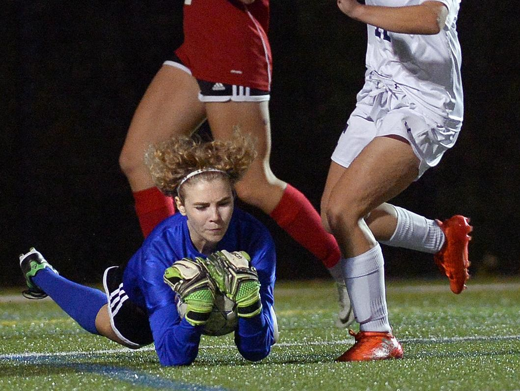 Penfield goalie Jessica Pegg dives on the ball in front of Webster Thomas' Abigayle VanDerWoude. Pegg had one save in Penfield's 2-0 shutout.