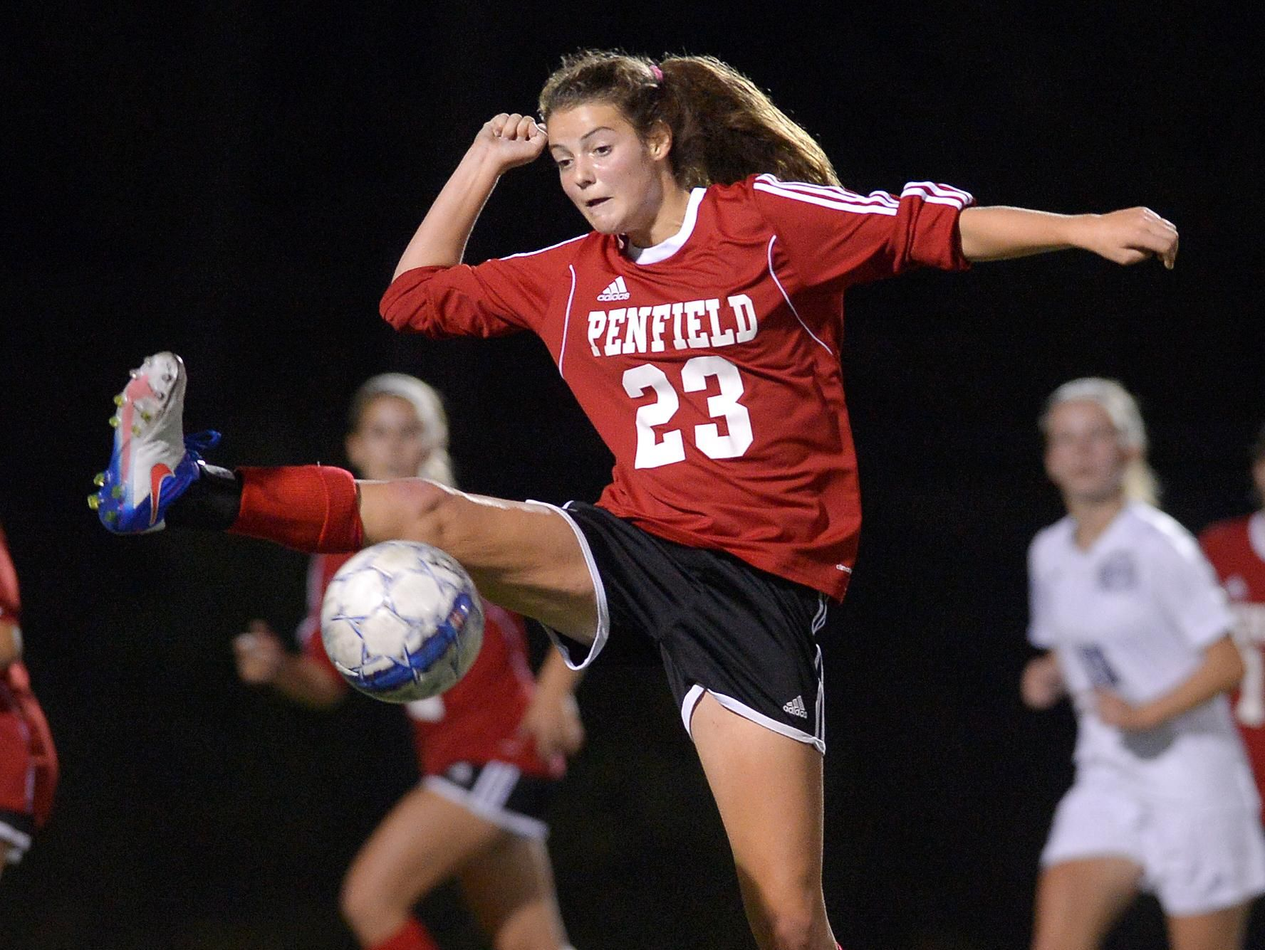 Penfield's Sophie Richiusa reaches to settle the ball.