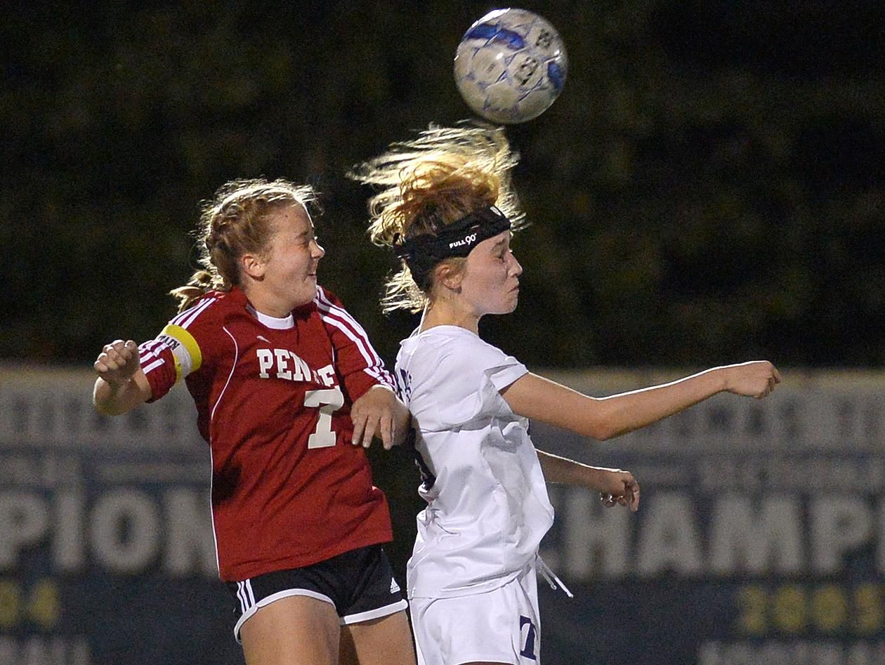 Webster Thomas' Hannah Leask, right, reaches a header in front of Penfield's Katie Summerson.