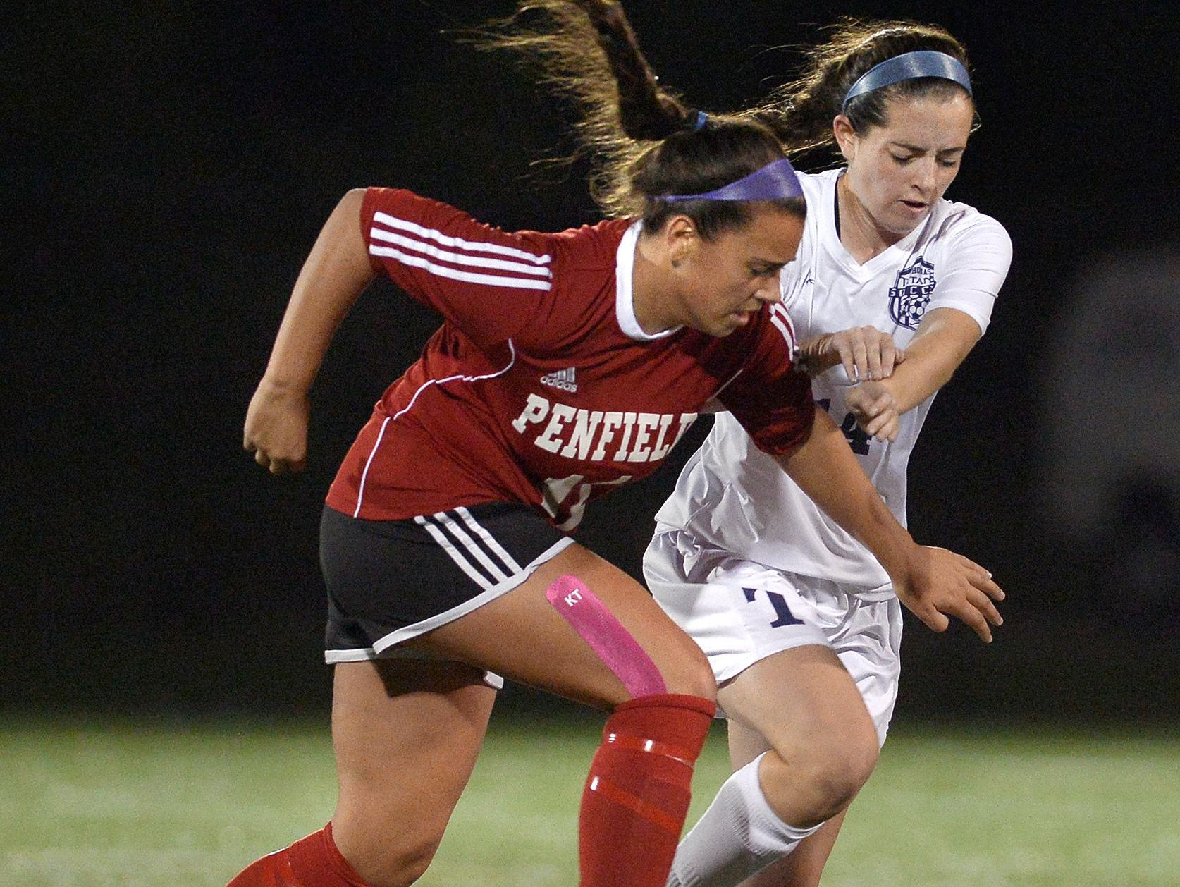 Penfield's Lauren Faillace, left, and Webster Thomas' Micaela Johnson vie for the ball.