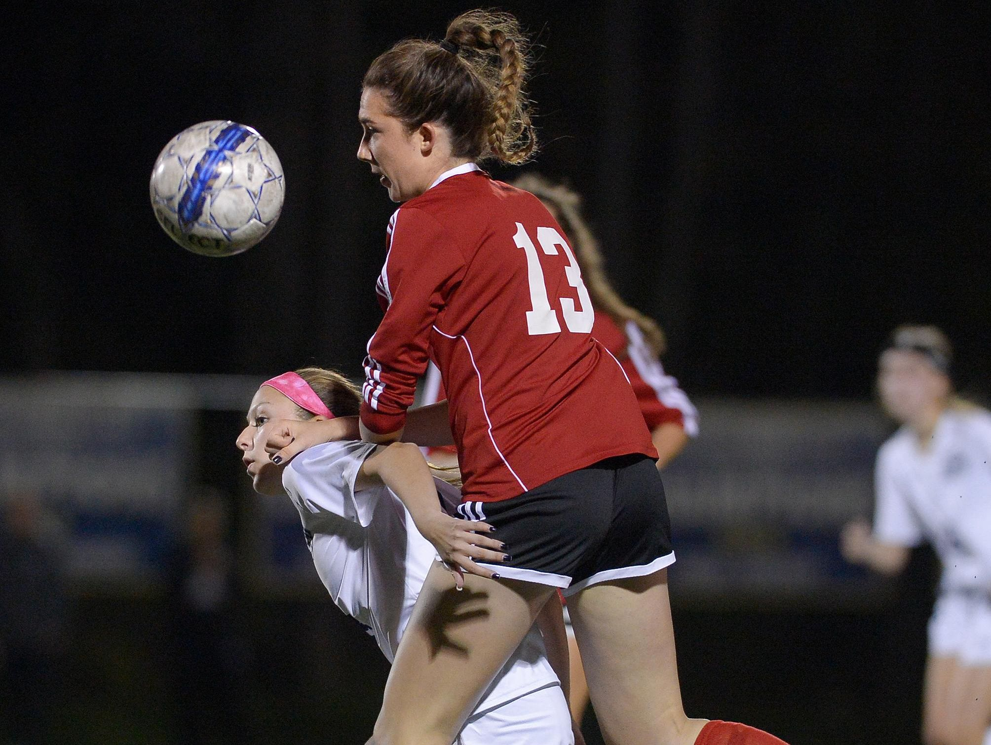 Penfield's Bre McGrath, right, pressures Webster Thomas' Jada Lucarelli for posession of the ball.