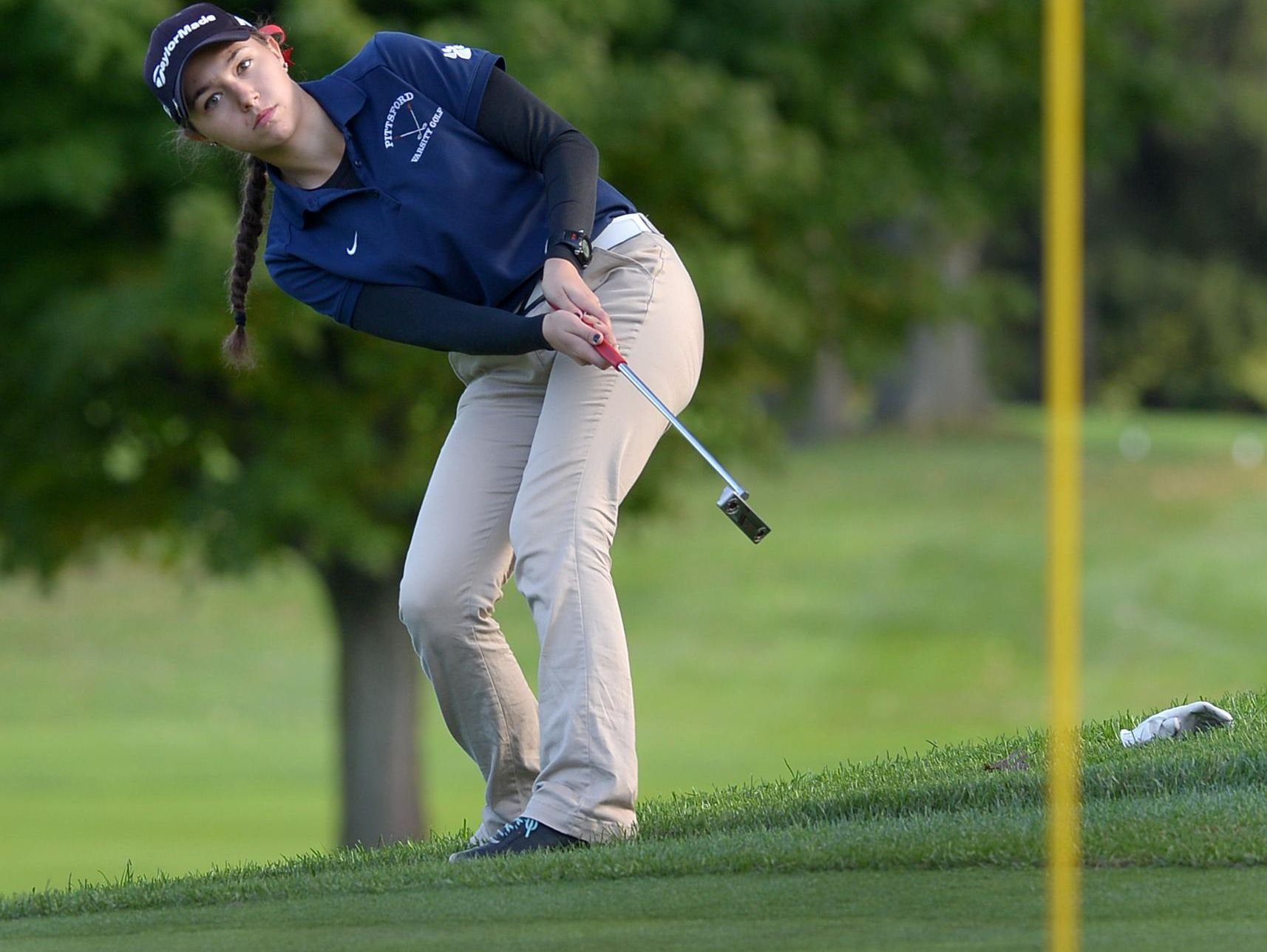 Pittsford's Sydney Ball tries to coax her putt in at No. 17 but just misses. Ball finished with an 85 to advance to states.