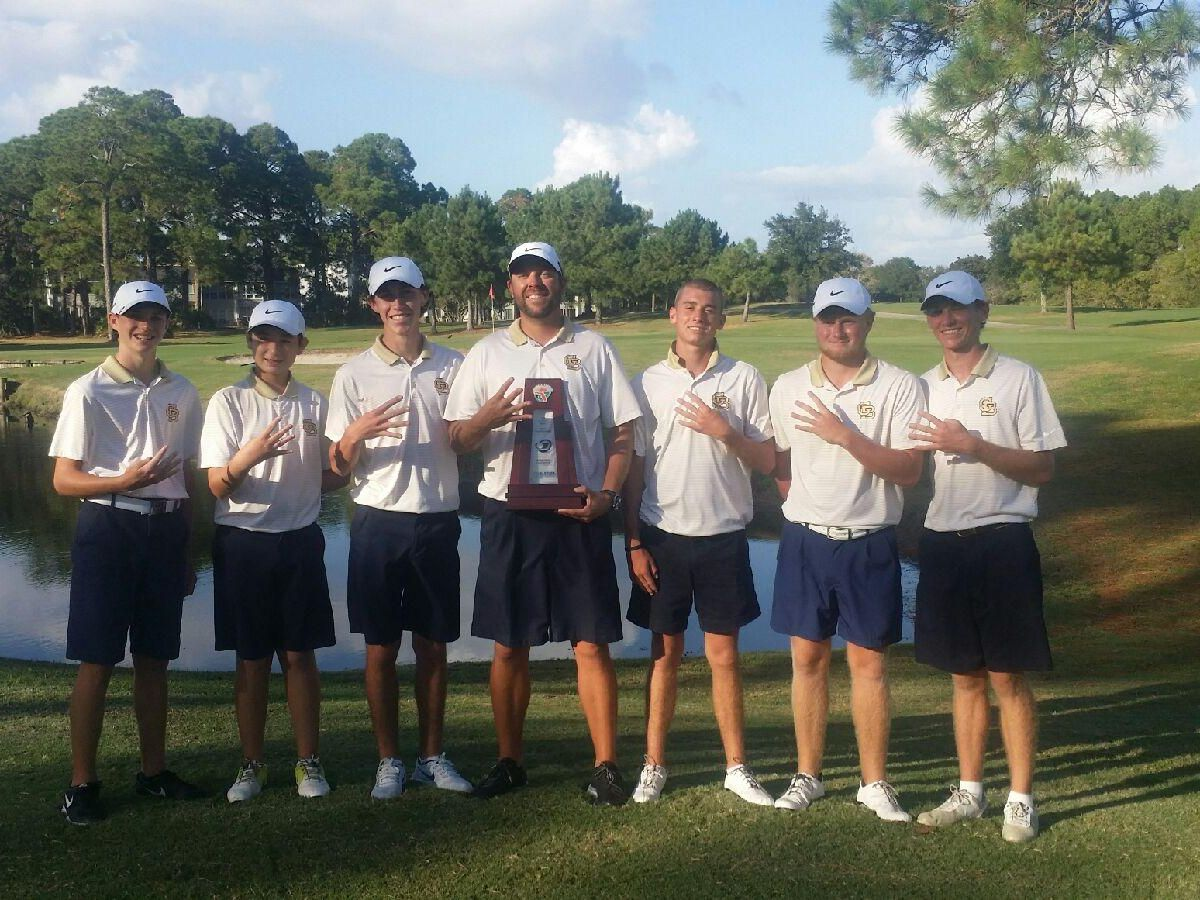 Brian Richards (far right), who was the tournament medalist, along with the other members of the Gulf Breeze High boys golf team hold up four fingers to signify winning the Region 1-2A Boys Golf Title for the fourth consecutive year Monday at Bay Point Resort in Panama City.