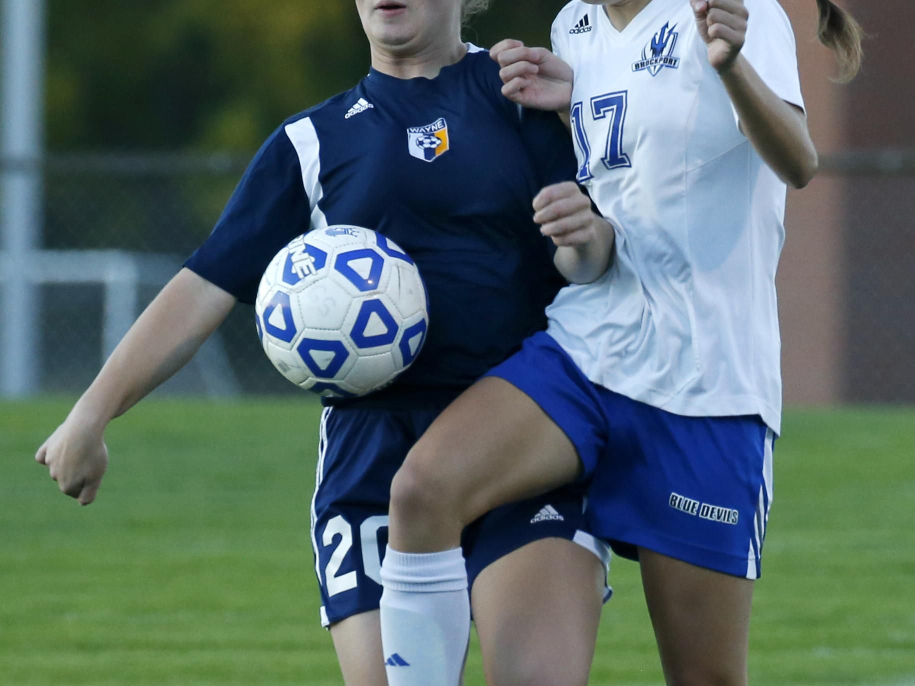 Wayne's Hannah Burns, left, and Brockport's Leah Daly battle for a loose ball during the first half Wednesday at Brockport High School.