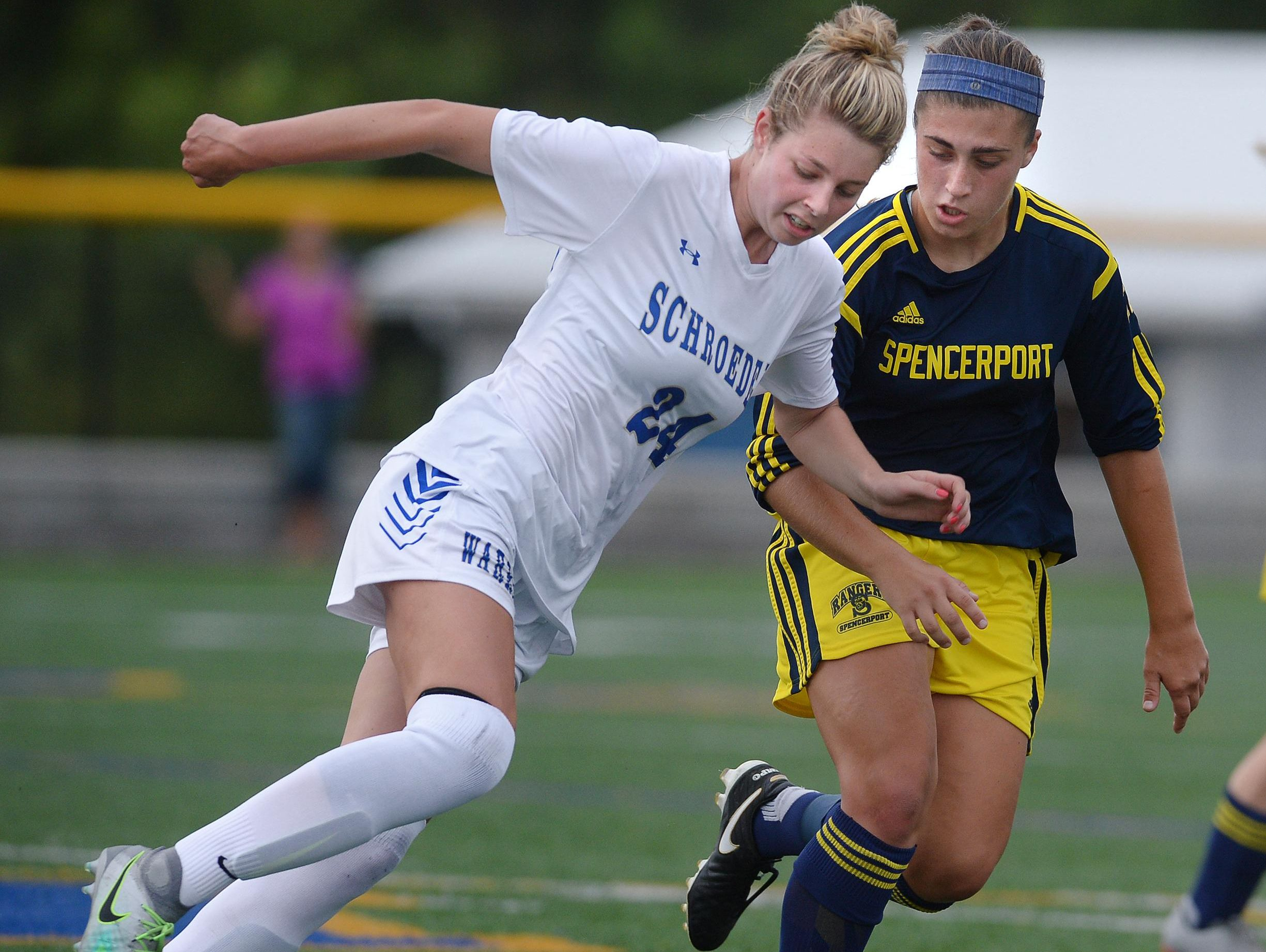 Webster Schroeder's Maddy Lowe, left, is defended by Spencerport's Olivia Wall during a regular season game at Webster Schroeder High School on Saturday, Sept. 17, 2016. Webster Schroeder and Spencerport played to a 1-1 draw.