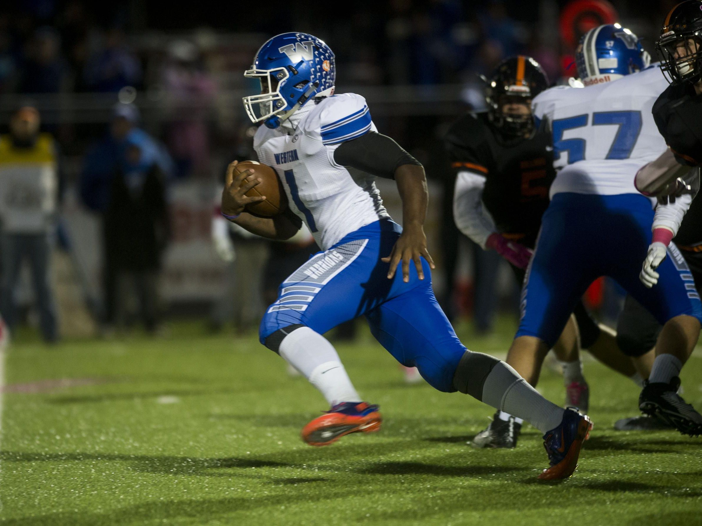 Western's Jalen Marshall carries in the Warriors' victory over Brighton Friday night. The Warriors won the Kensington Valley Lakes Division crown.
