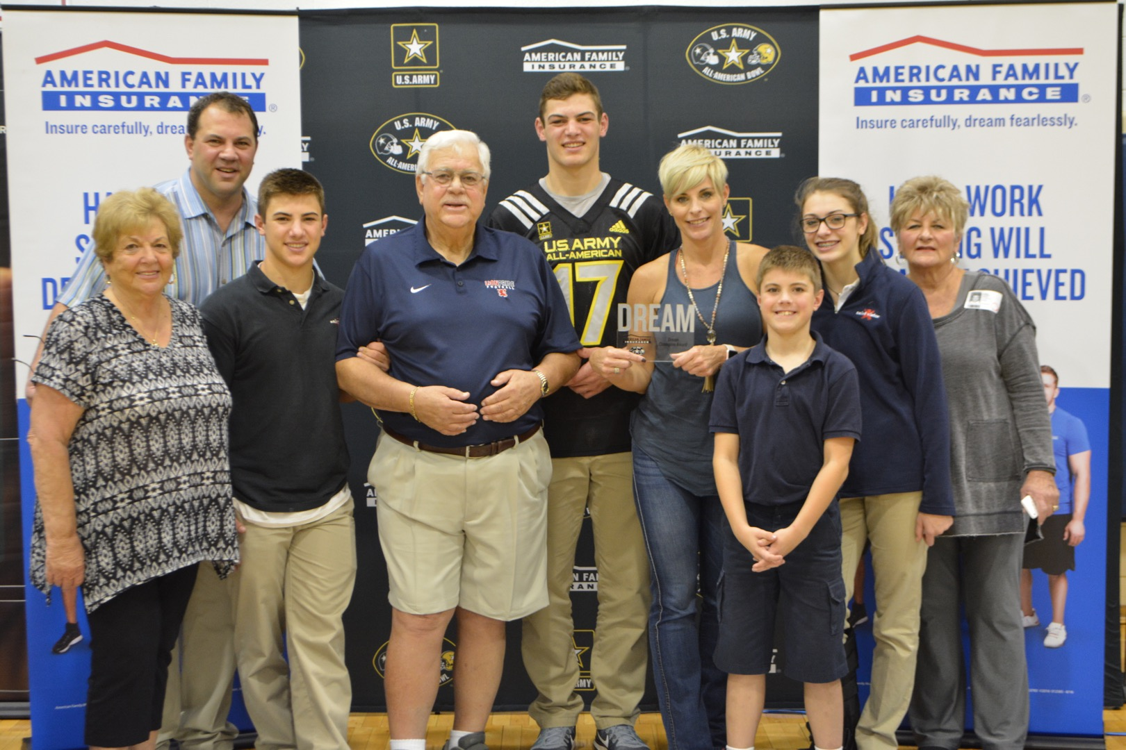 Cole presented his mother Kandace, father Frank, sister Frankie, brothers Cooper and Casey with the Dream Champion Award. (Photo: AAG)