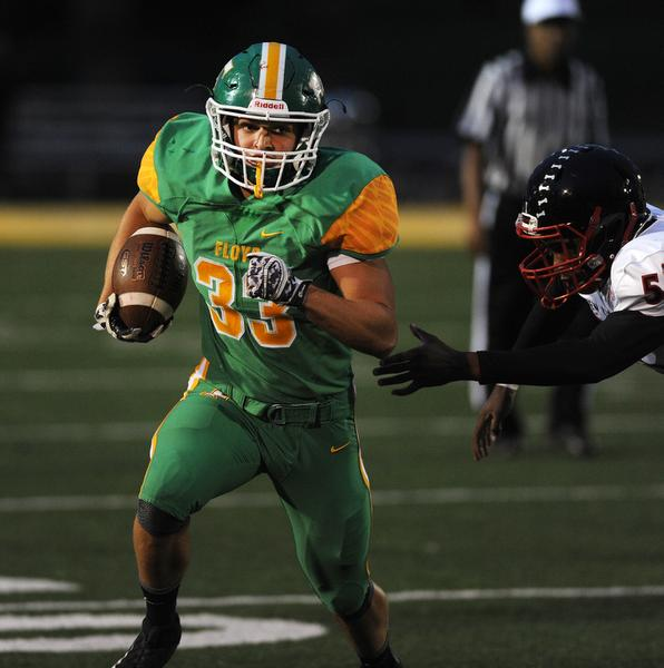 Floyd Central's Jason Cundiff (33) runs against New Albany on Friday at Floyd Central High School. (Photo by David Lee Hartlage, Special to The Courier-Journal) Oct. 14, 2016