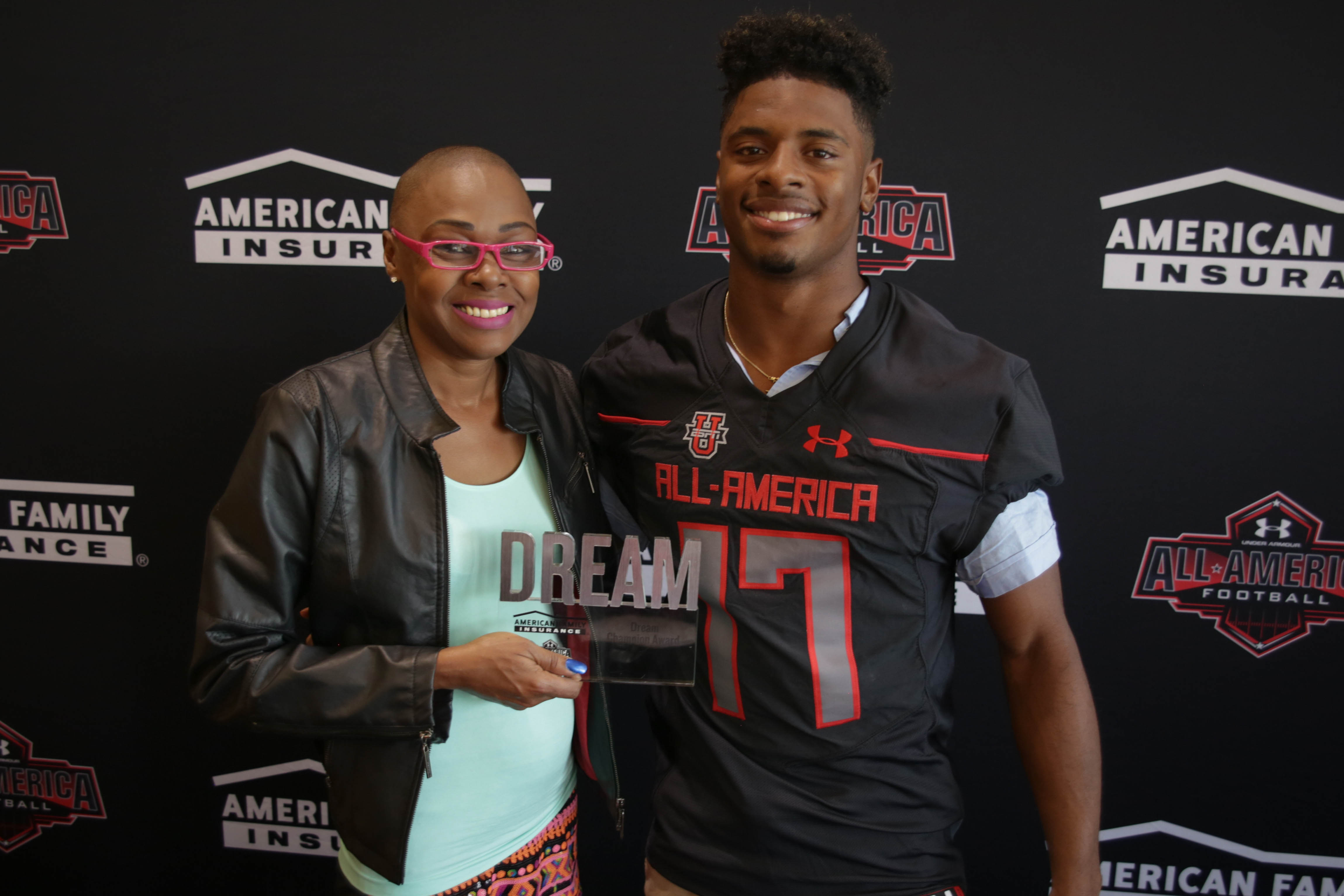 Tre Brown presents his American Family Insurance Dream Champion award to his mom, Beverly Brewer (Photo: Intersport)