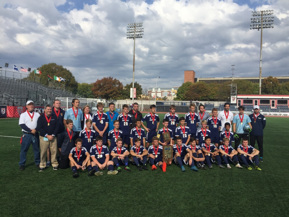 Members of the Providence boys soccer team gather with their Class 1A state runner-up trophy Saturday at Carroll Stadium in Indianapolis.
