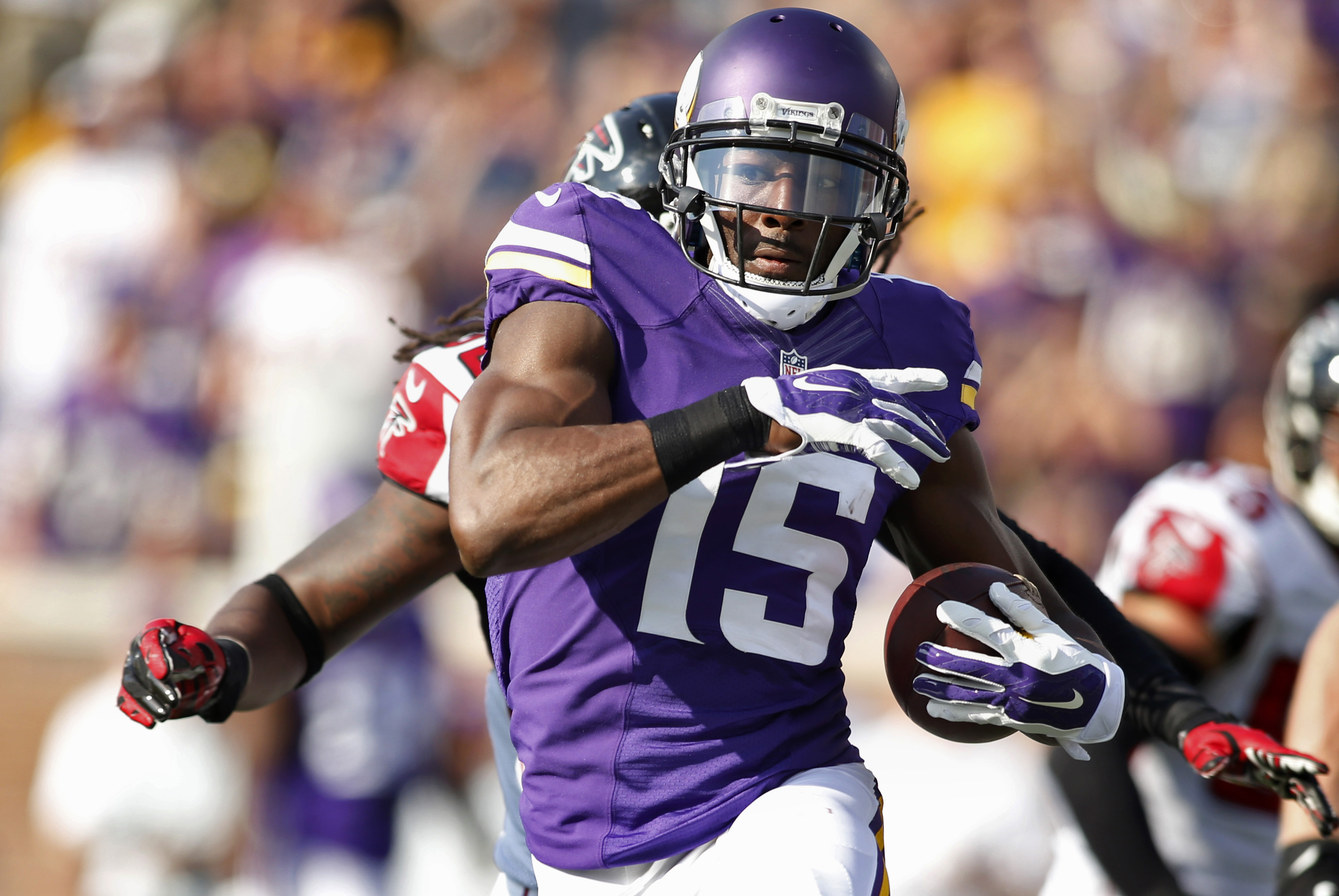 Sep 28, 2014; Minneapolis, MN, USA; Minnesota Vikings wide receiver Greg Jennings (15) catches a pass for 29 yards against the Atlanta Falcons in the first quarter at TCF Bank Stadium. Mandatory Credit: Bruce Kluckhohn-USA TODAY Sports ORG XMIT: USATSI-180116 ORIG FILE ID: 20140928_gma_sk1_068.jpg