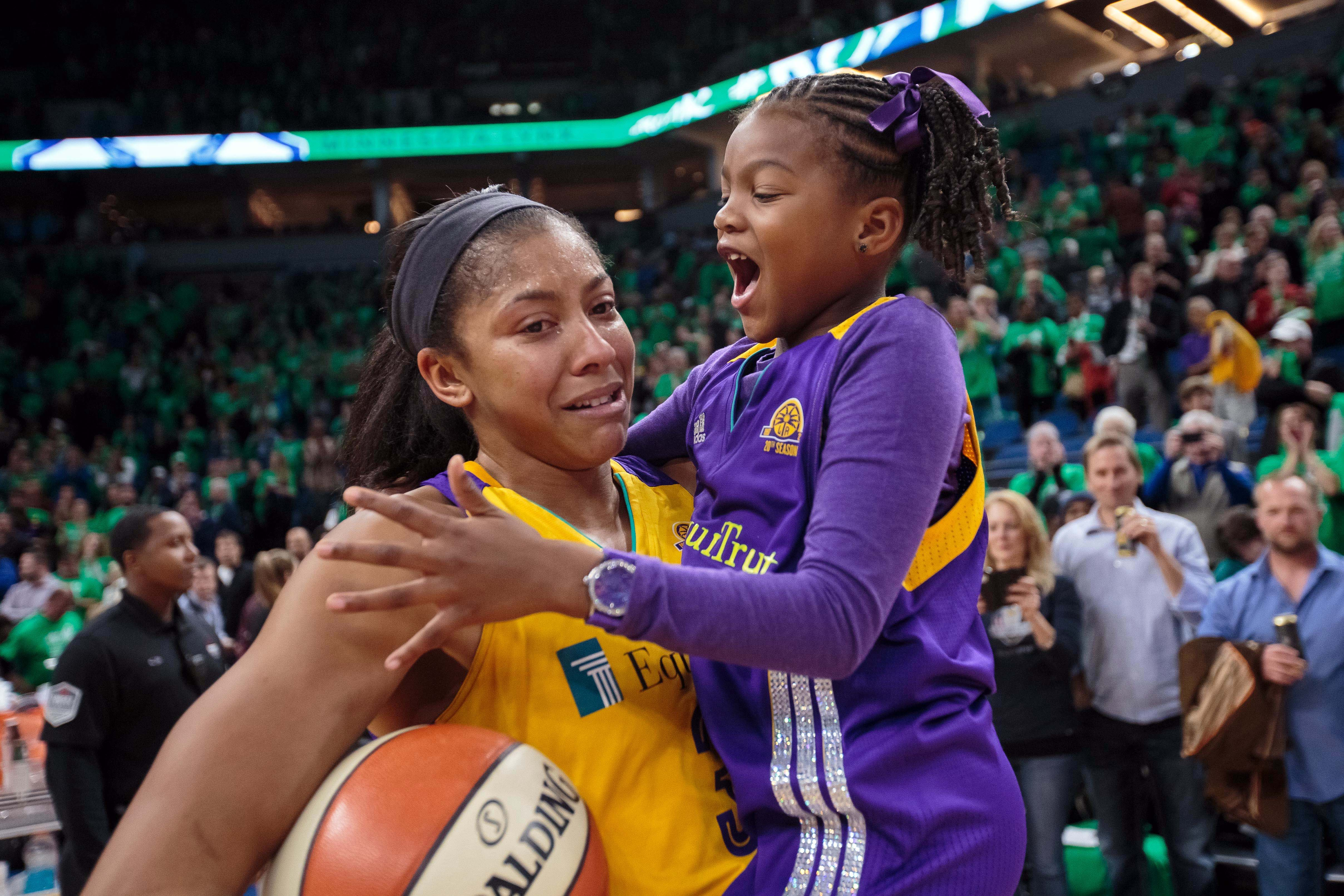 Oct 20, 2016; Minneapolis, MN, USA; Los Angeles Sparks forward Candace Parker (3) celebrates the WNBA Championship with her daughter against the Minnesota Lynx in game five of the WNBA Finals. at Target Center. The Los Angeles Sparks beat the Minnesota Lynx 77-76. Mandatory Credit: Brad Rempel-USA TODAY Sports ORG XMIT: USATSI-337416 ORIG FILE ID: 20161020_tdc_ai9_218.JPG