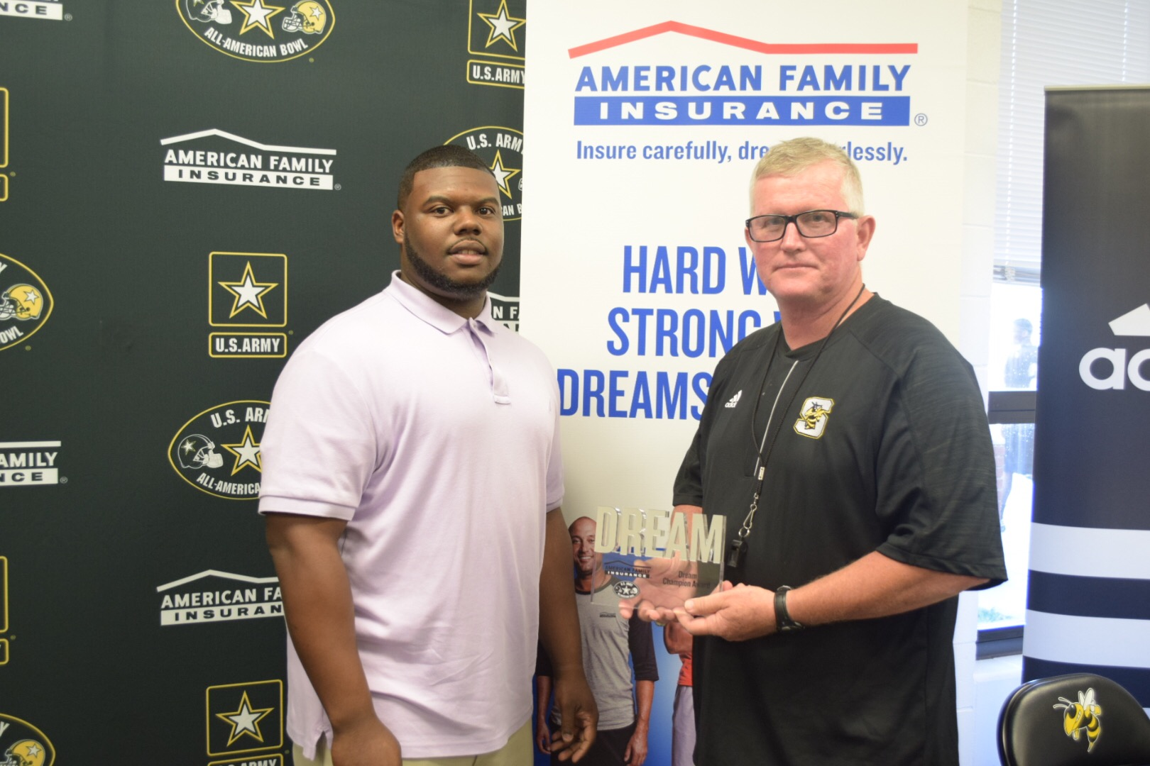 Willie presented his Coach Ricky Woods and brother Emmanuel Ware with the Dream Champion Award. (Photo: AAG)