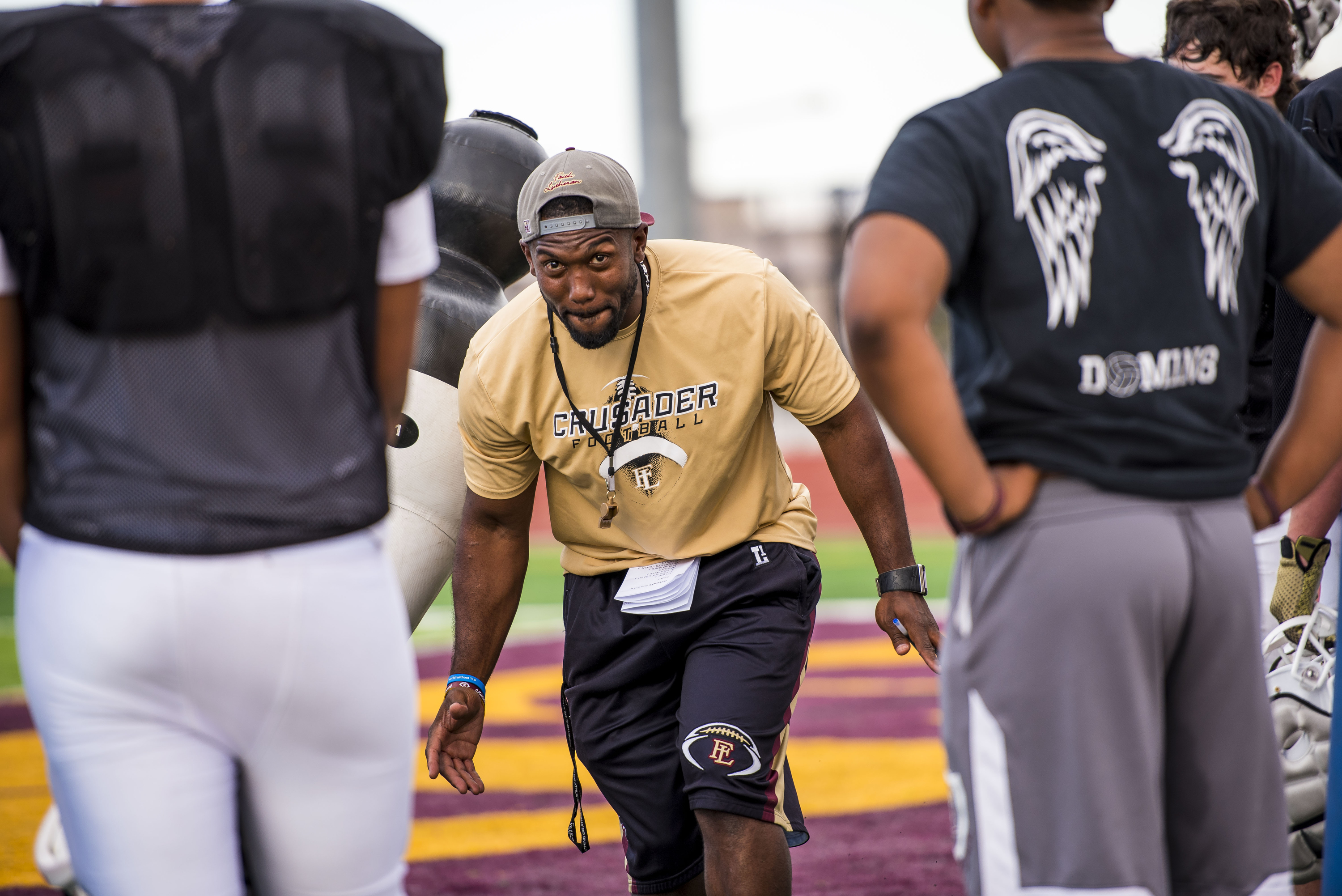 Sep 27, 2016 -- Las Vegas, NV, U.S.A -- Vernon Fox instructs his team during football practice at Faith Lutheran High School. Feature on Randall Cunningham and Vernon Fox who are both former NFL players, current high school coaches and ordained ministers and African-Americans. That puts them at the intersection of what NFL players are doing during the National Anthem, the trickle-down effect at high schools, the struggles of young people in urban areas and faith and race. -- Photo by Joshua Dahl/USA TODAY Sports Images, Gannett ORG XMIT: US 135535 Cunningham Fox 9/26/2016 [Via MerlinFTP Drop]