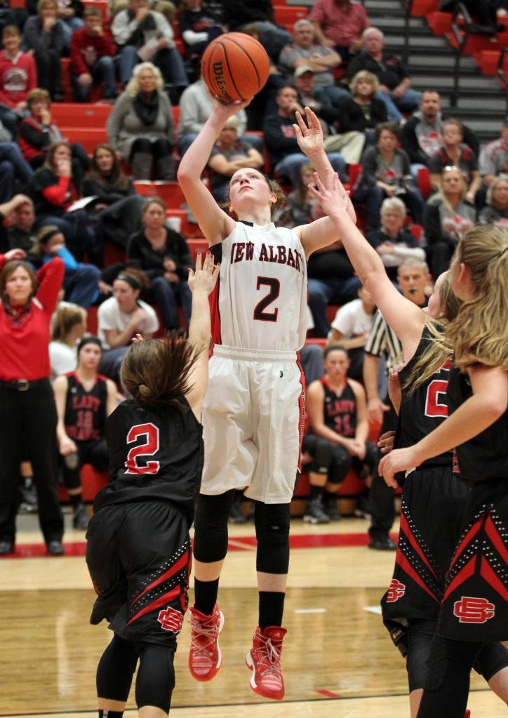 New Albany's Julyen Condra (2) fights to get her shot off under pressure from Brownstown Central High School's Brooklyn Snodgrass (2) during their game at New Albany High School in New Albany, Indiana. November 10, 2016