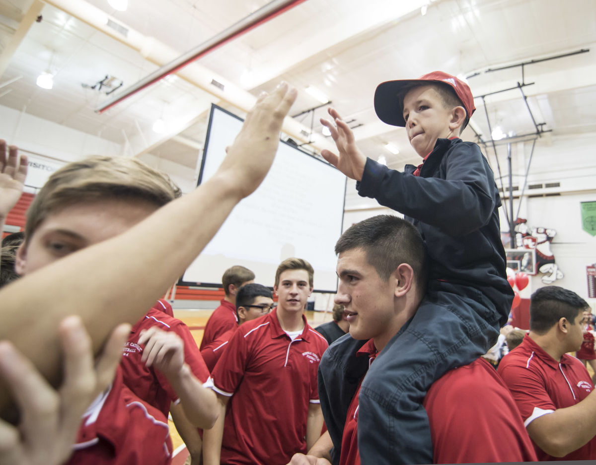 Jack Johnson gives high-fives after signing his letter of intent for Nebraska (Photo: Jack Wragge, Norfolk Daily News via Associated Press)