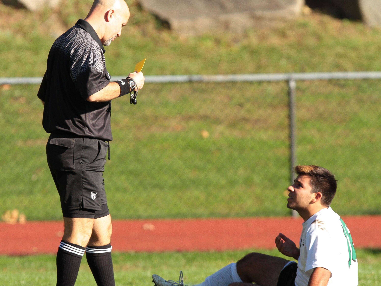 Irvington's Lucas Garcia reacts to a referee after receiving a yellow during a Class B boys soccer quarterfinal game at Irvington High School Oct. 28, 2014.