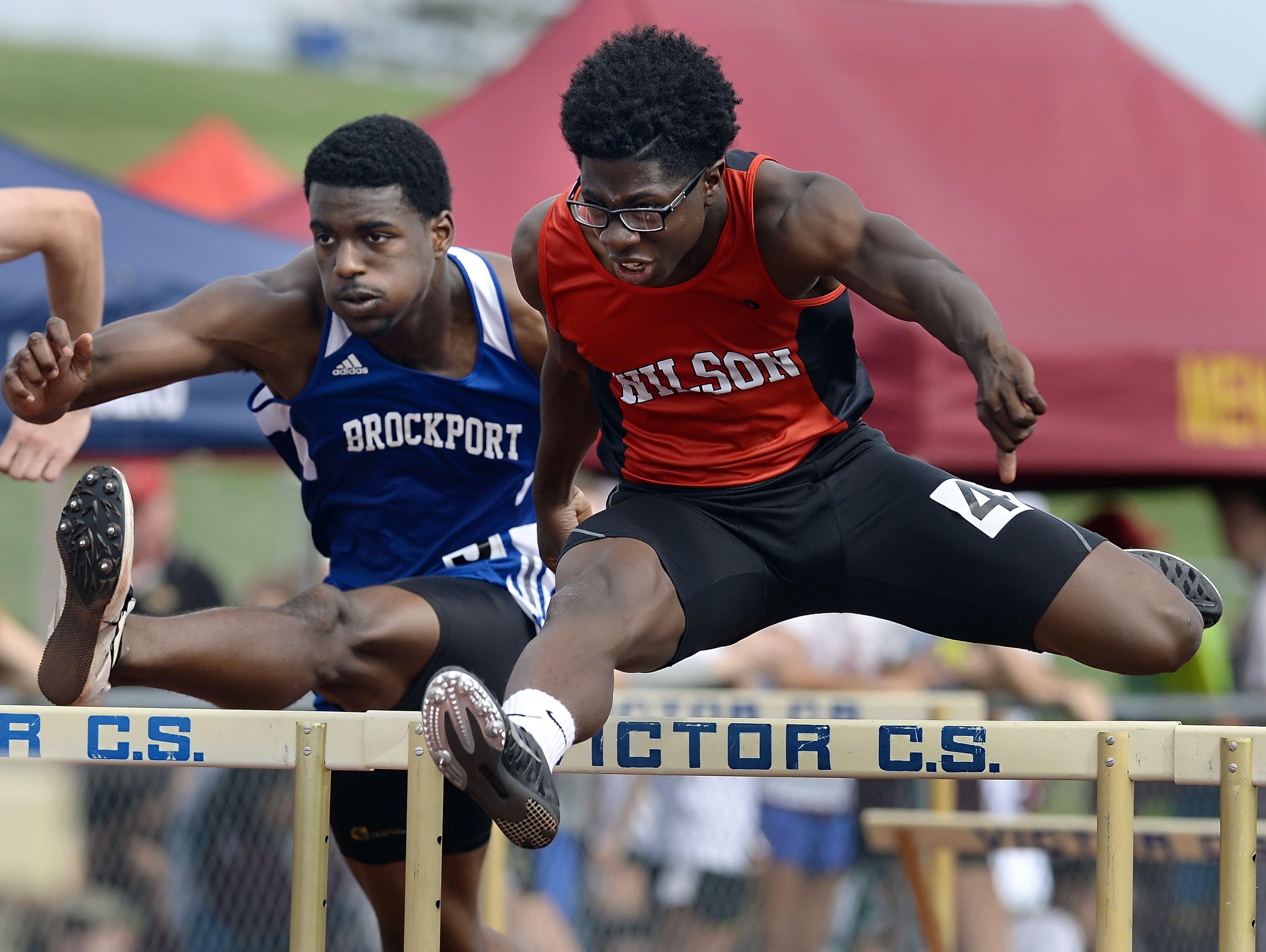 Wilson's Kelly Brown runs the 110 meter hurdles.