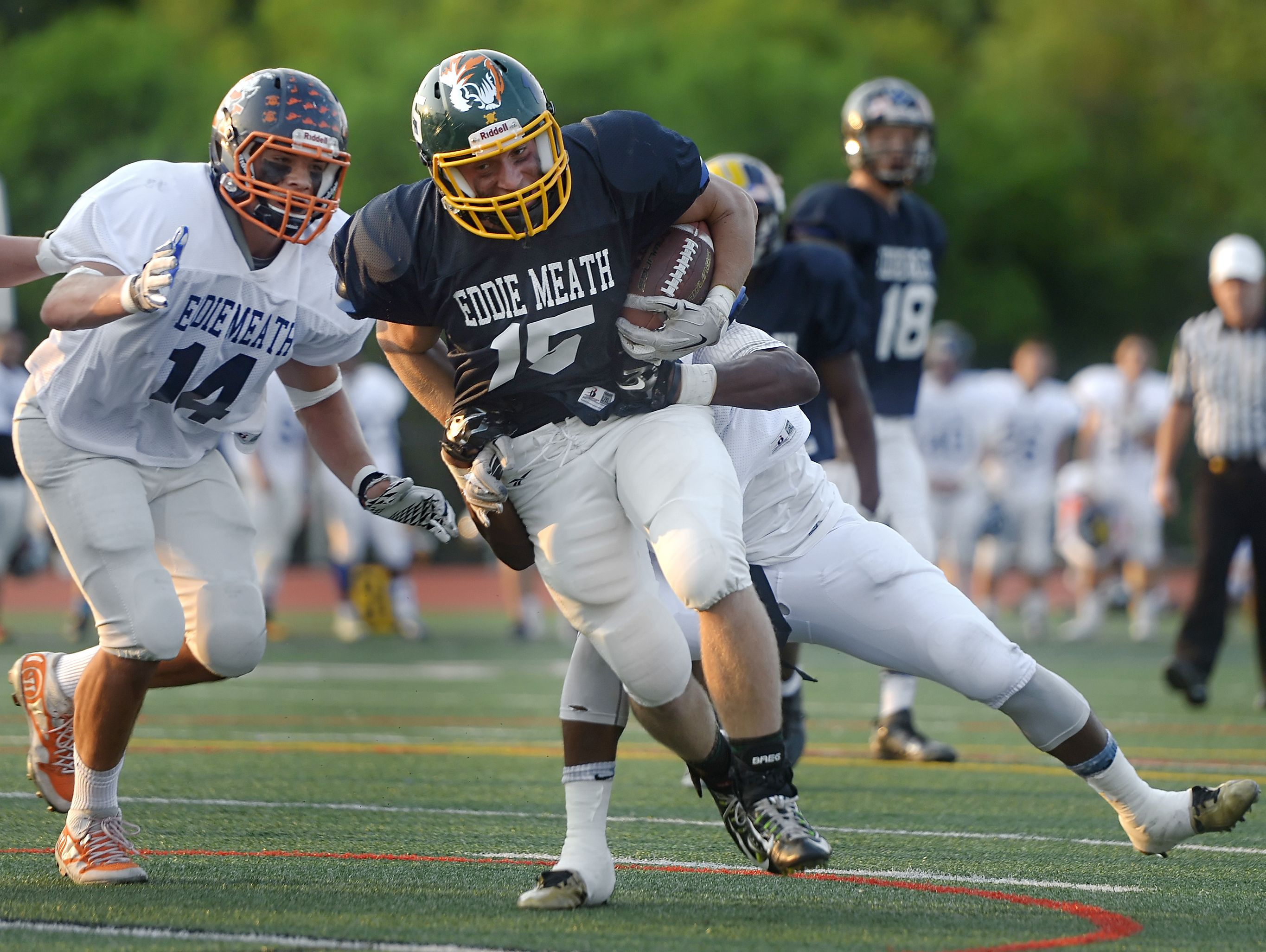 Alexander's Tyler Laird breaks a tackle during a run for a touchdown in last year's Eddie Meath All-Star Football Game.