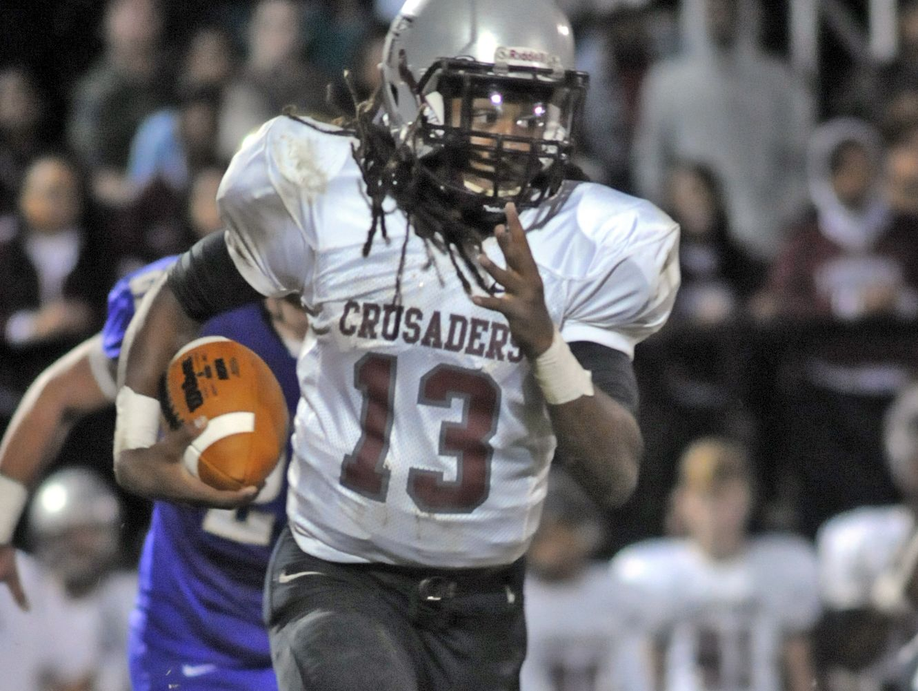 Liberty's Corey Newble (13) runs the ball against CPA during Liberty Magnet at CPA during the 3A semifinal playoff game on Friday, Nov. 27, 2015 in Nashville, Tenn.