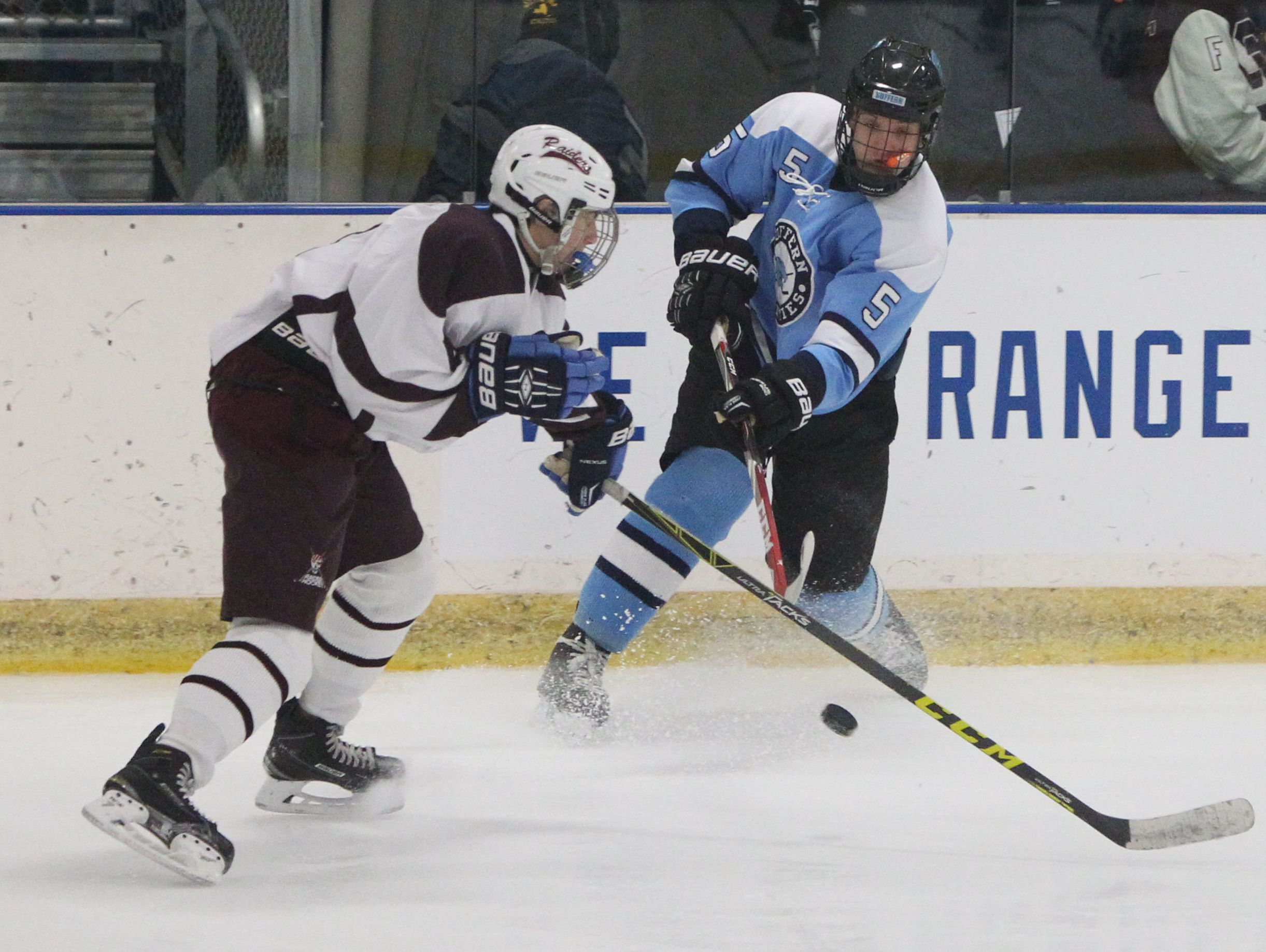 Scarsdale's Robbie Kramer pressures Suffern's David Rozitis during their game at the E.J. Murray rink in Yonkers Dec. 7, 2015. Scarsdale won 1-0.