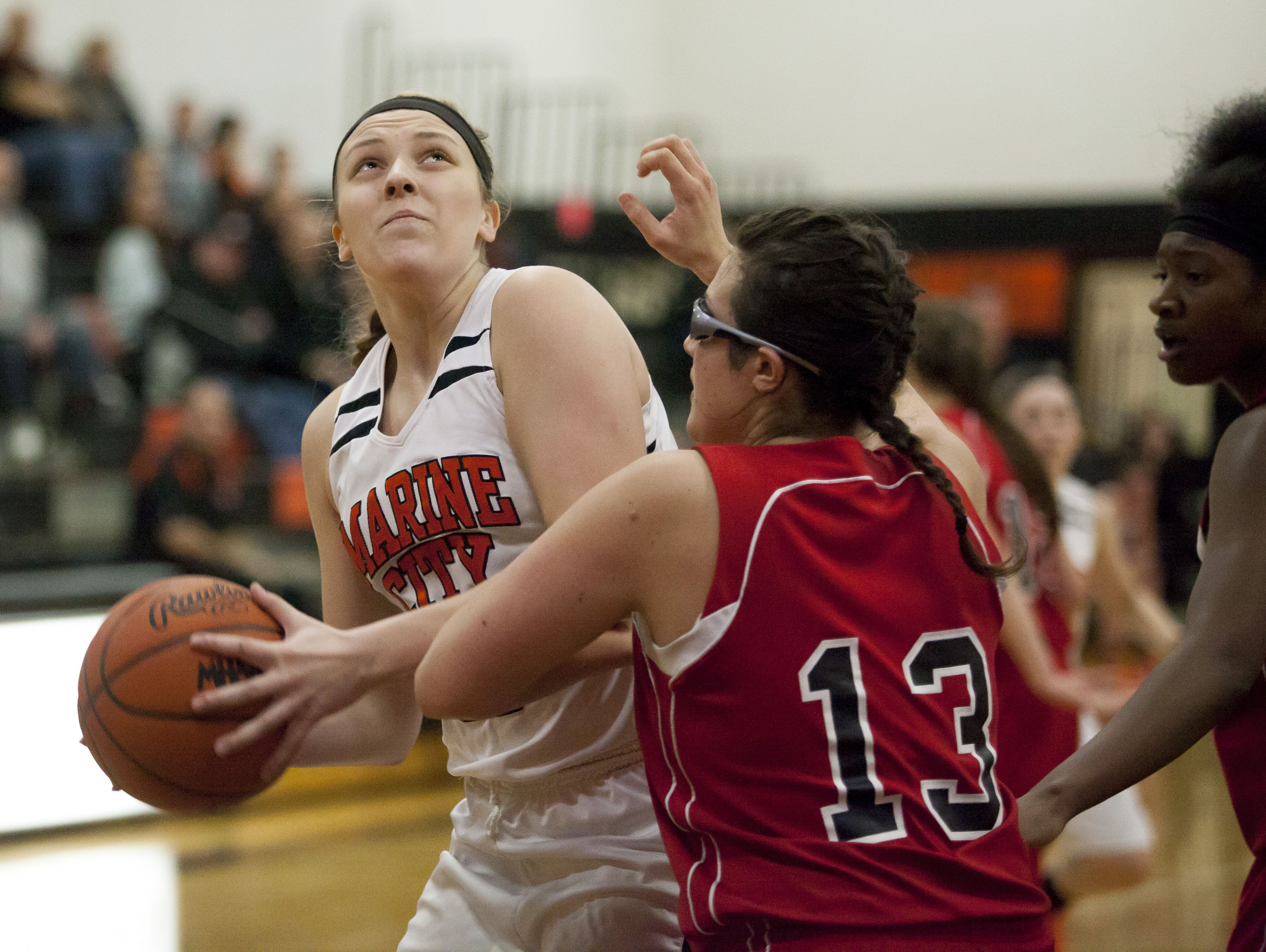 Marine City junior Paige Tranchida goes for a shot during a basketball game Thursday, Jan. 14, 2016 at Marine City High School.