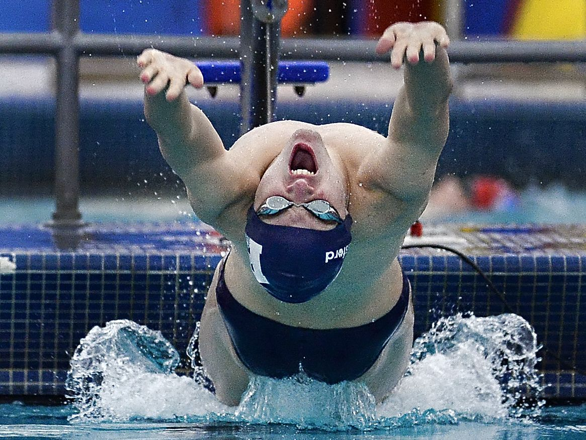 Pittsford's Casey Ransford starts the 100-yard backstroke during at Fairport High School on Jan. 14, 2016. Ransford won the race with a time of 55.92.