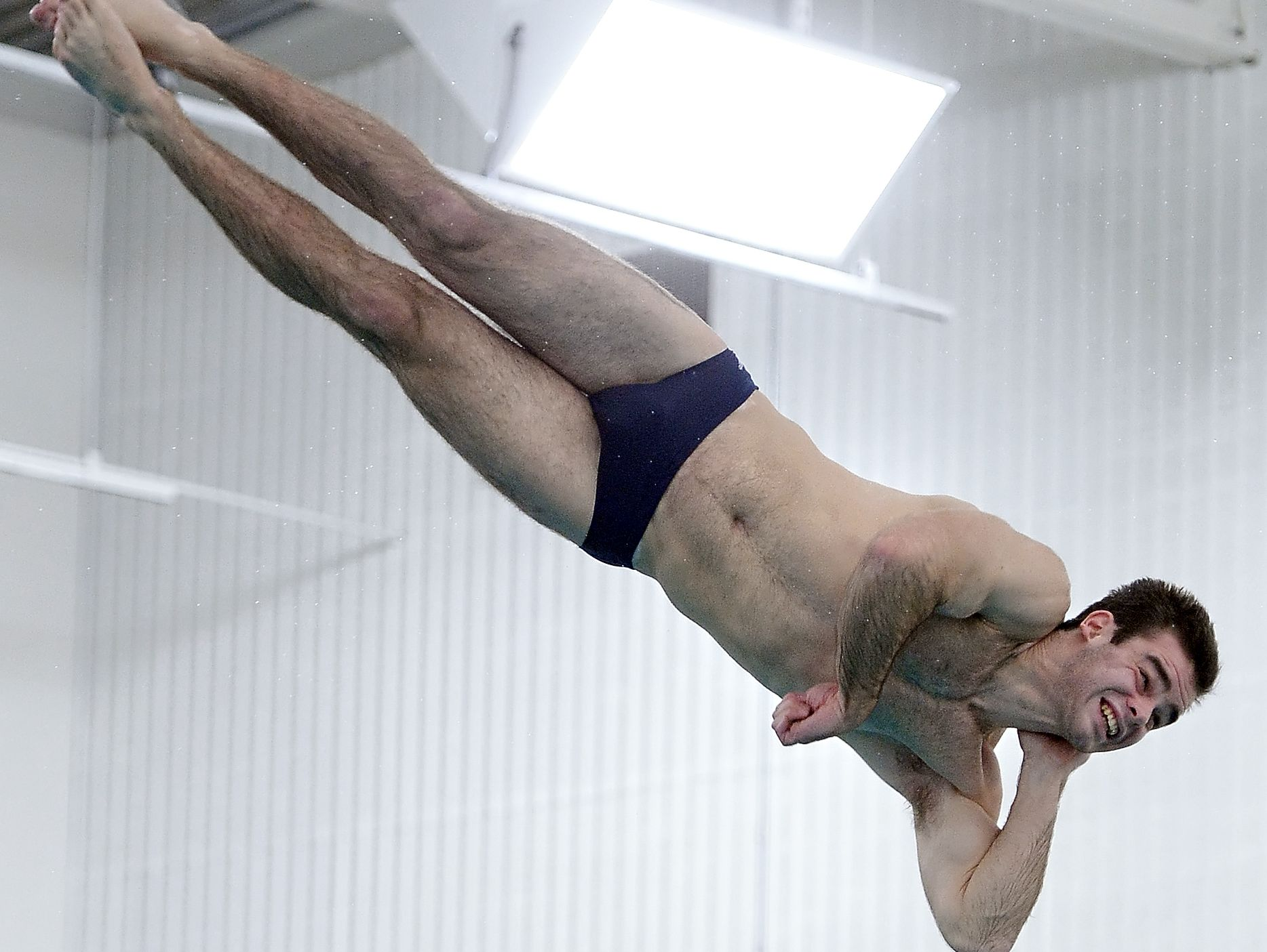 Pittsford's Sean Riley performs a dive on the way to a first-place finish with 310.15 points.