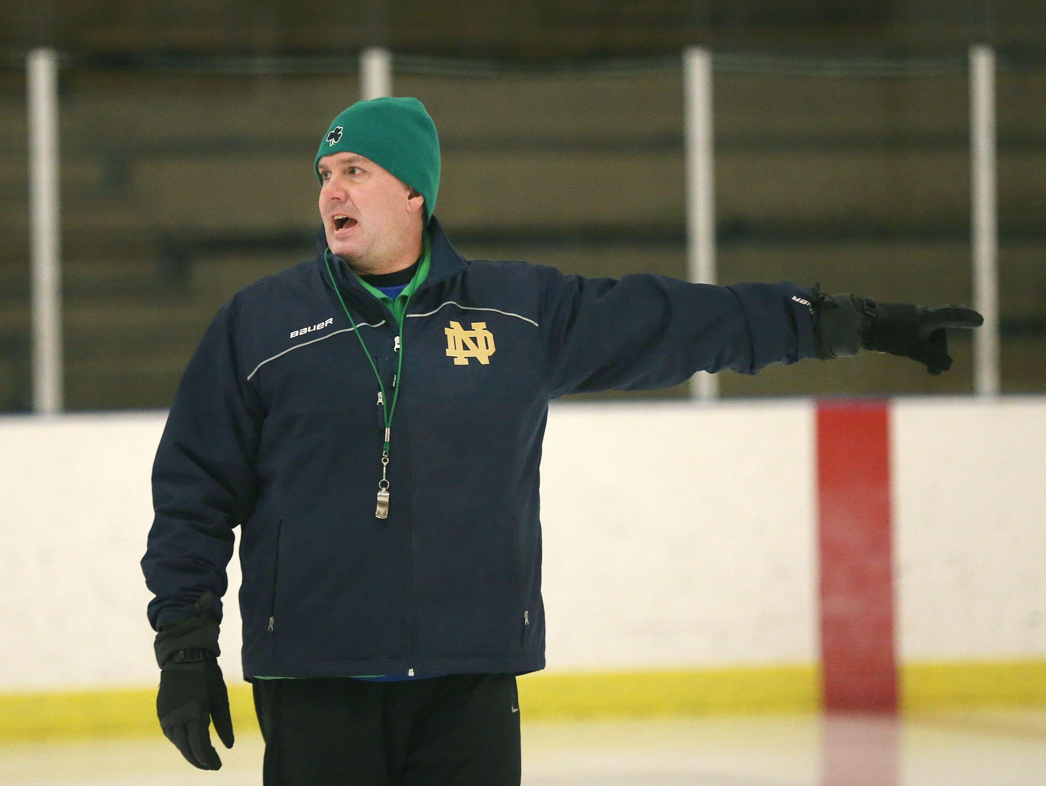 Batavia Notre Dame head coach Marc Staley runs an early-morning practice before school.
