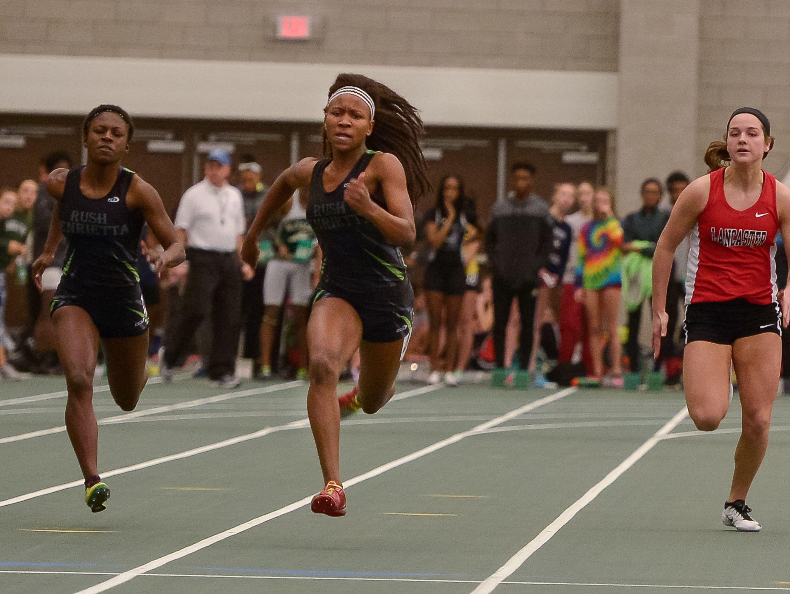 Rush-Henrietta sophomore Lanae-Tava Thomas, center, runs to win the 55 meters.