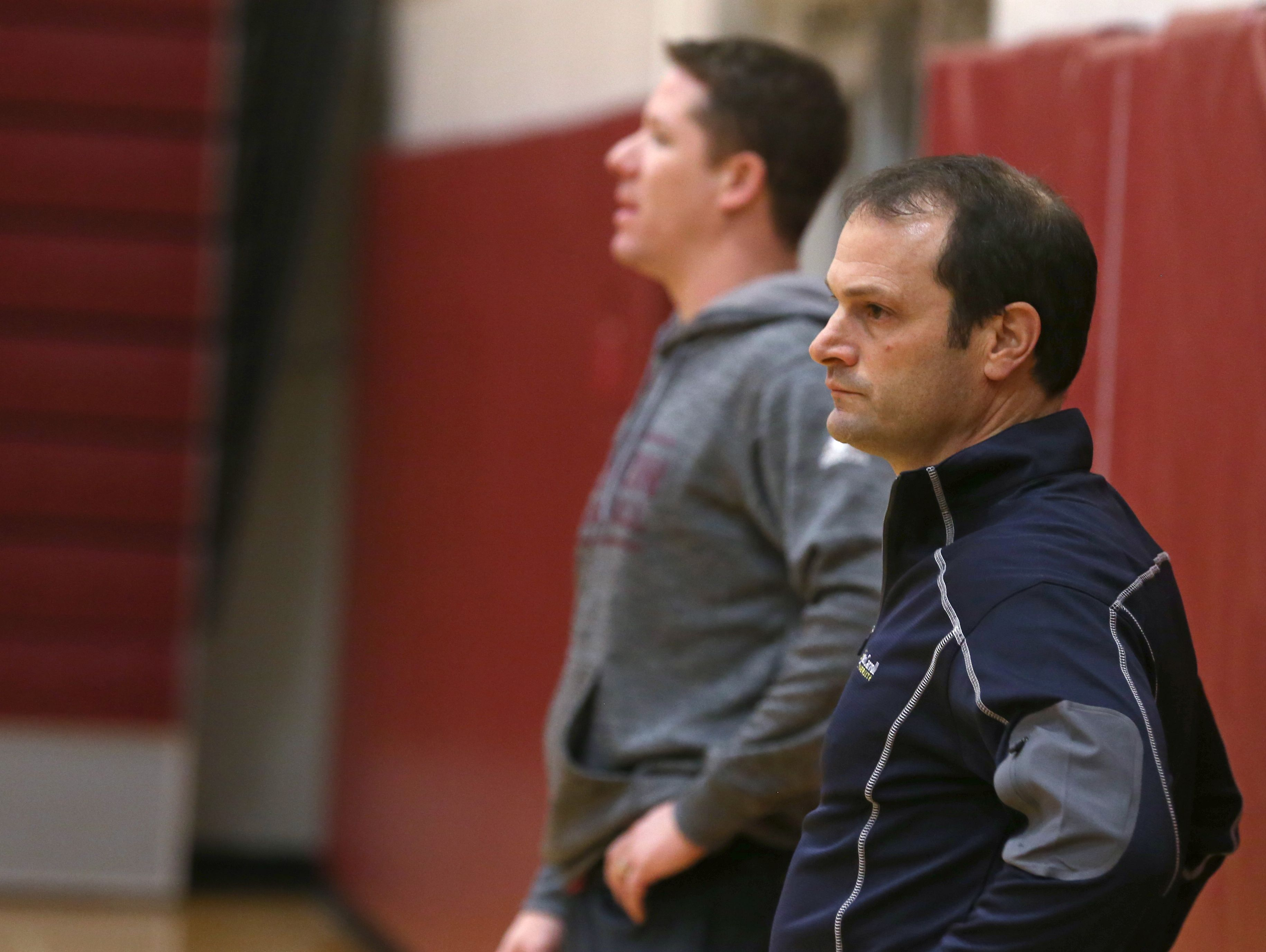 Jeff Amoroso, Pittsford Mendon boys varsity basketball assistant coach, right, works side-by-side with head coach Bob Nally during practice Tuesday.
