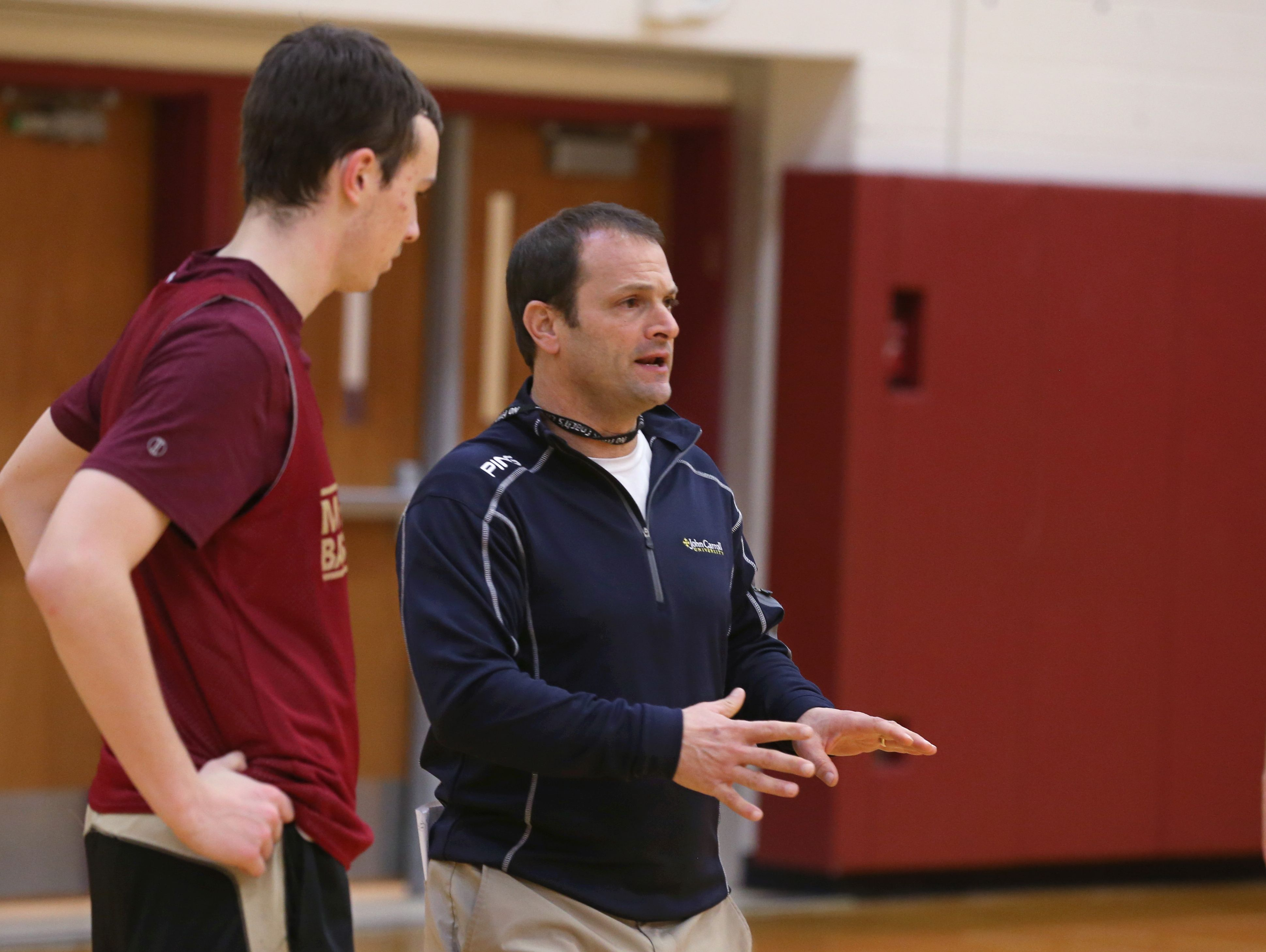 Jeff Amoroso, Pittsford Mendon boys varsity basketball assistant coach, works with the players during practice Tuesday at the high school.