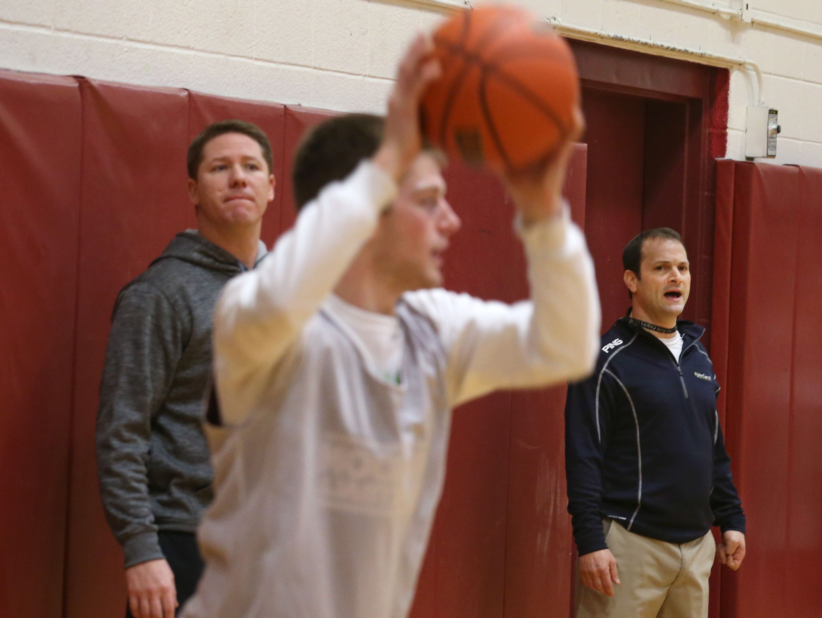 Jeff Amoroso, Pittsford Mendon boys varsity basketball assistant coach, right, works side-by-side with head coach Bob Nally, left, as they run in-bounds drills during practice Tuesday, Jan. 19, 2016 at the high school.