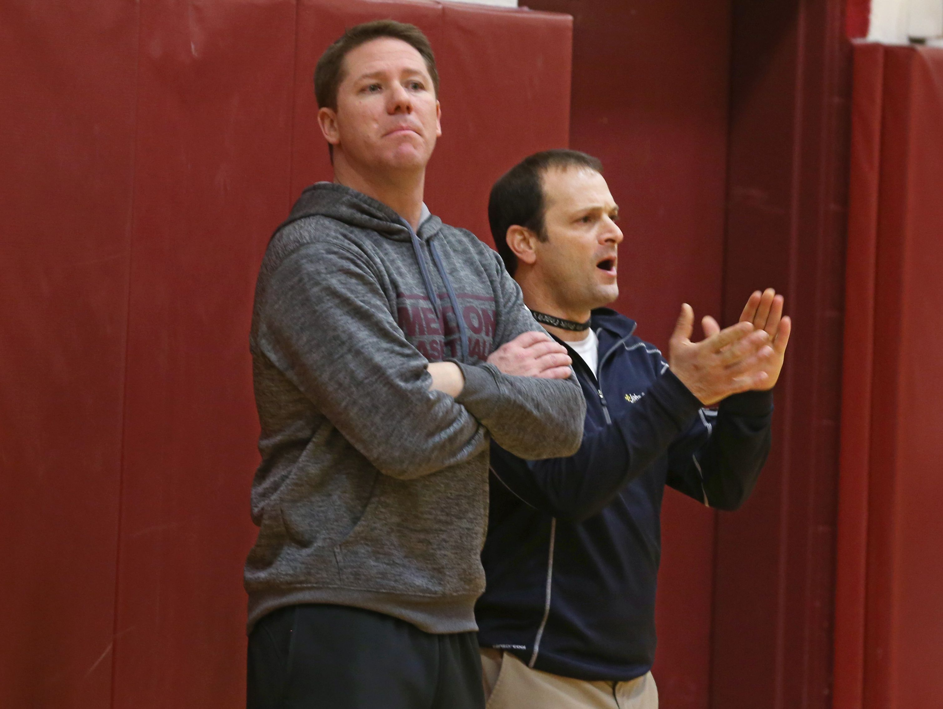 Jeff Amoroso, Pittsford Mendon boys varsity basketball assistant coach, right, works side-by-side with head coach Bob Nally, left, during practice Tuesday, Jan. 19, 2016 at the high school.