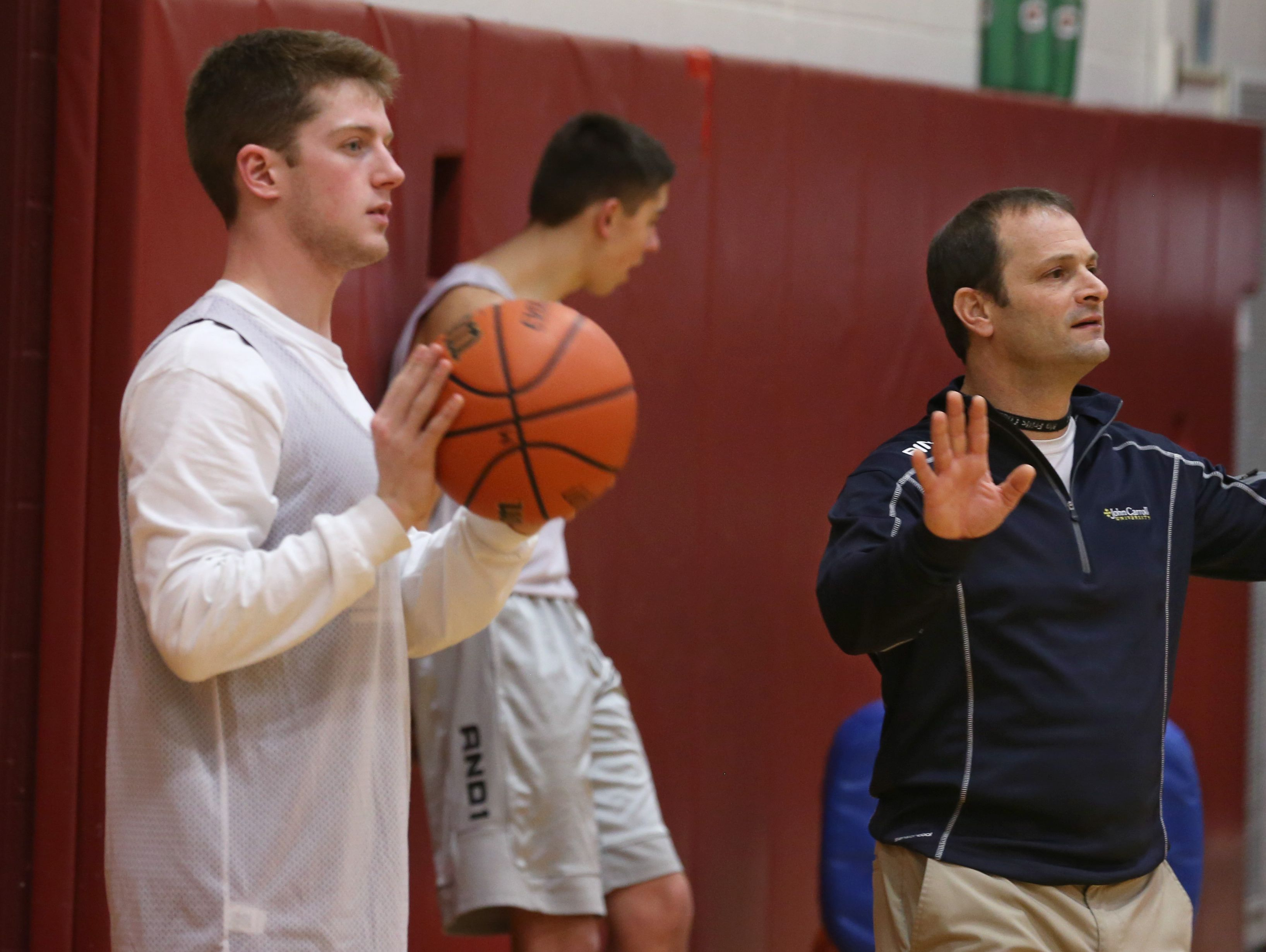Jeff Amoroso, Pittsford Mendon boys varsity basketball assistant coach, works with the players during practice Tuesday, Jan. 19, 2016 at the high school.